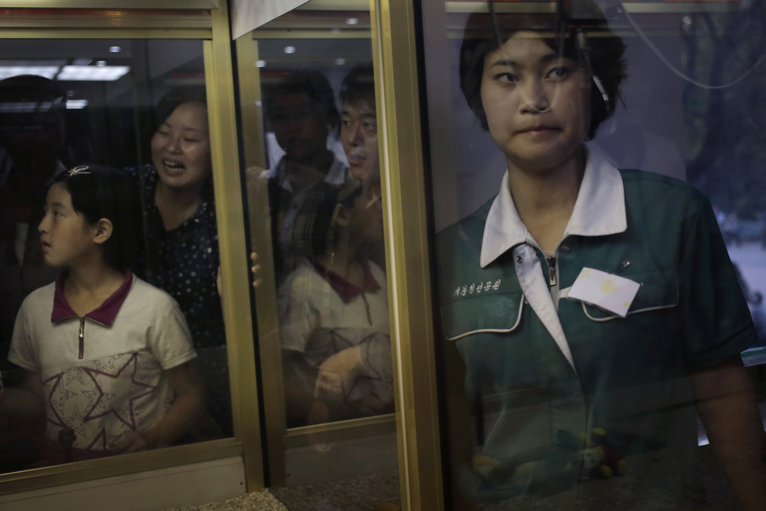 Sept. 3, 2014. North Koreans watch as their others play an arcade game at the Kaeson Youth Amusement Park in Pyongyang, North Korea.