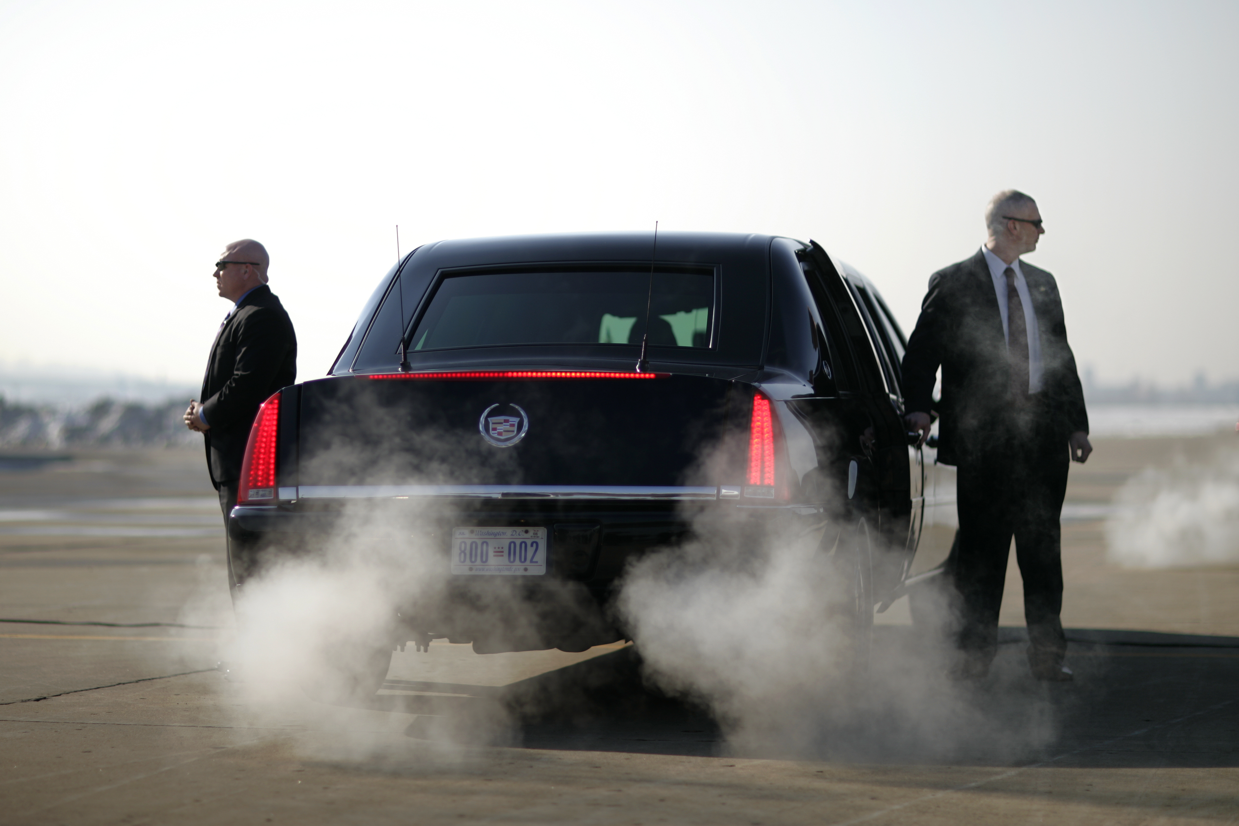 Secret Service agents stand guard around President Bush's Limousine on the tarmac as he arrives in Kansas City, Mo., Jan. 25, 2007.