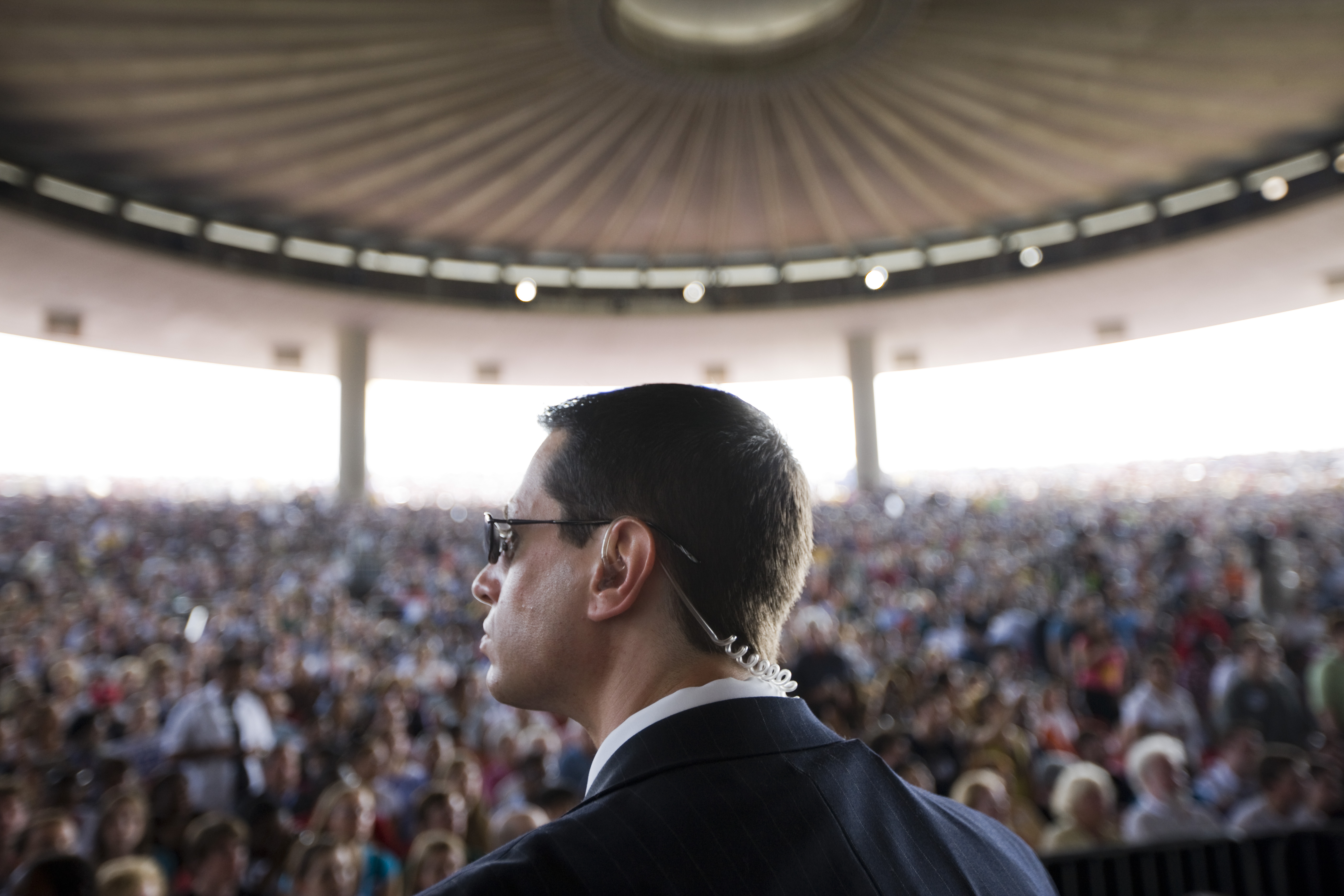 A Secret Service agent watches the crowd as President Barrack Obama speaks in Holmdel, N.J. on July 16, 2009.