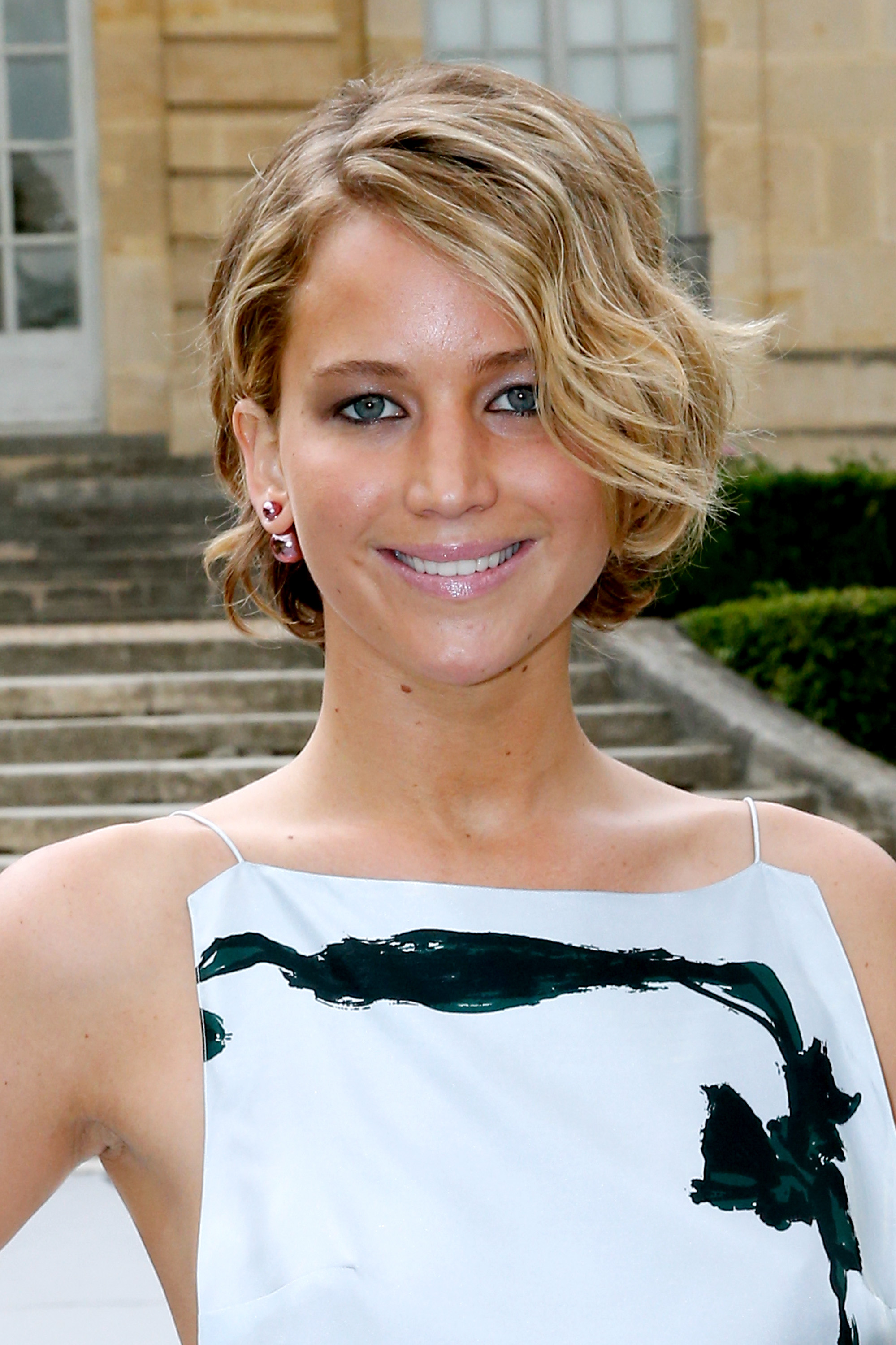 Actress Jennifer Lawrence attends the Christian Dior show as part of Paris Fashion Week - Haute Couture Fall/Winter 2014-2015.
