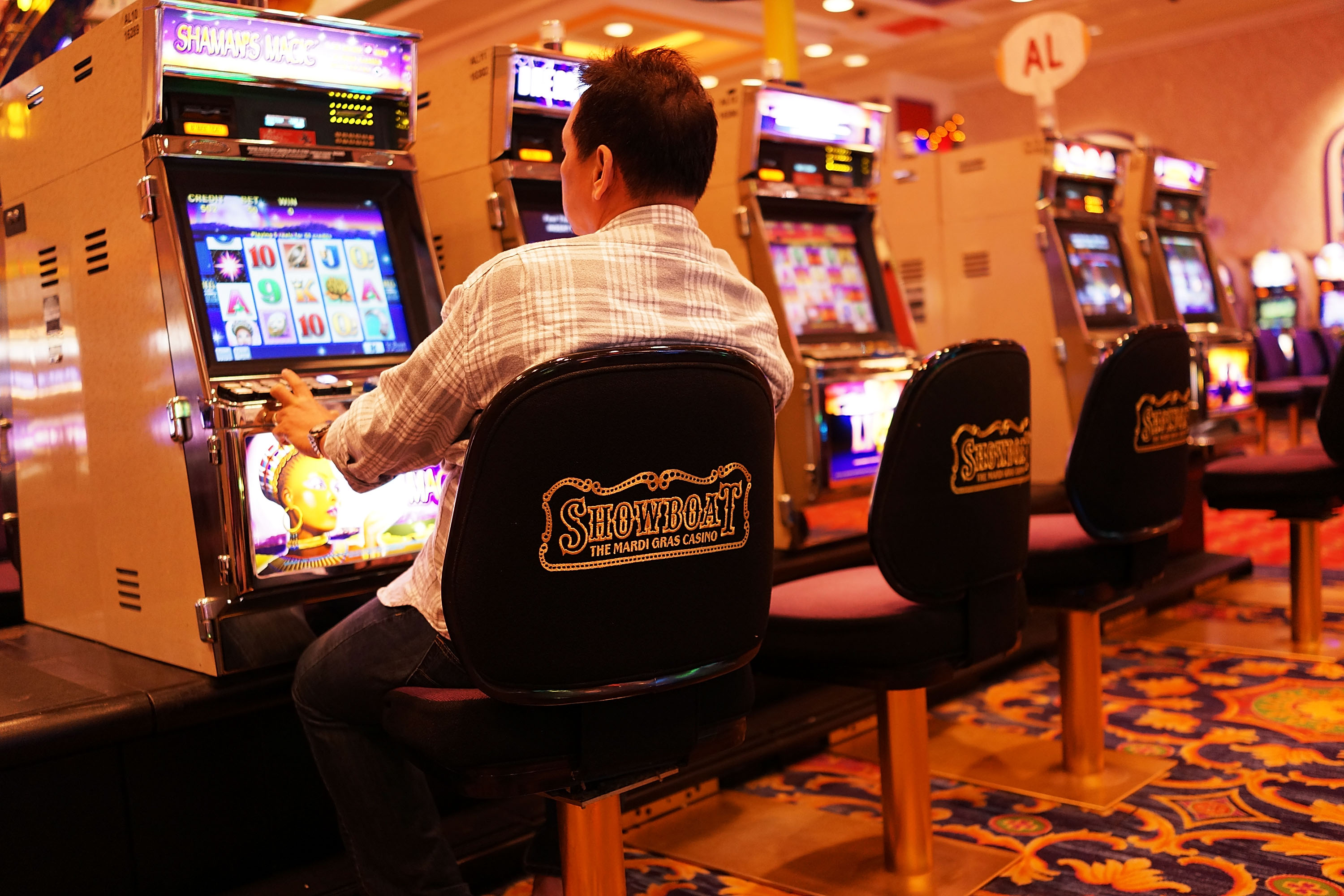 A man gambles at the Showboat casino, which is scheduled to close, in Atlantic City, N.J., on July 29, 2014