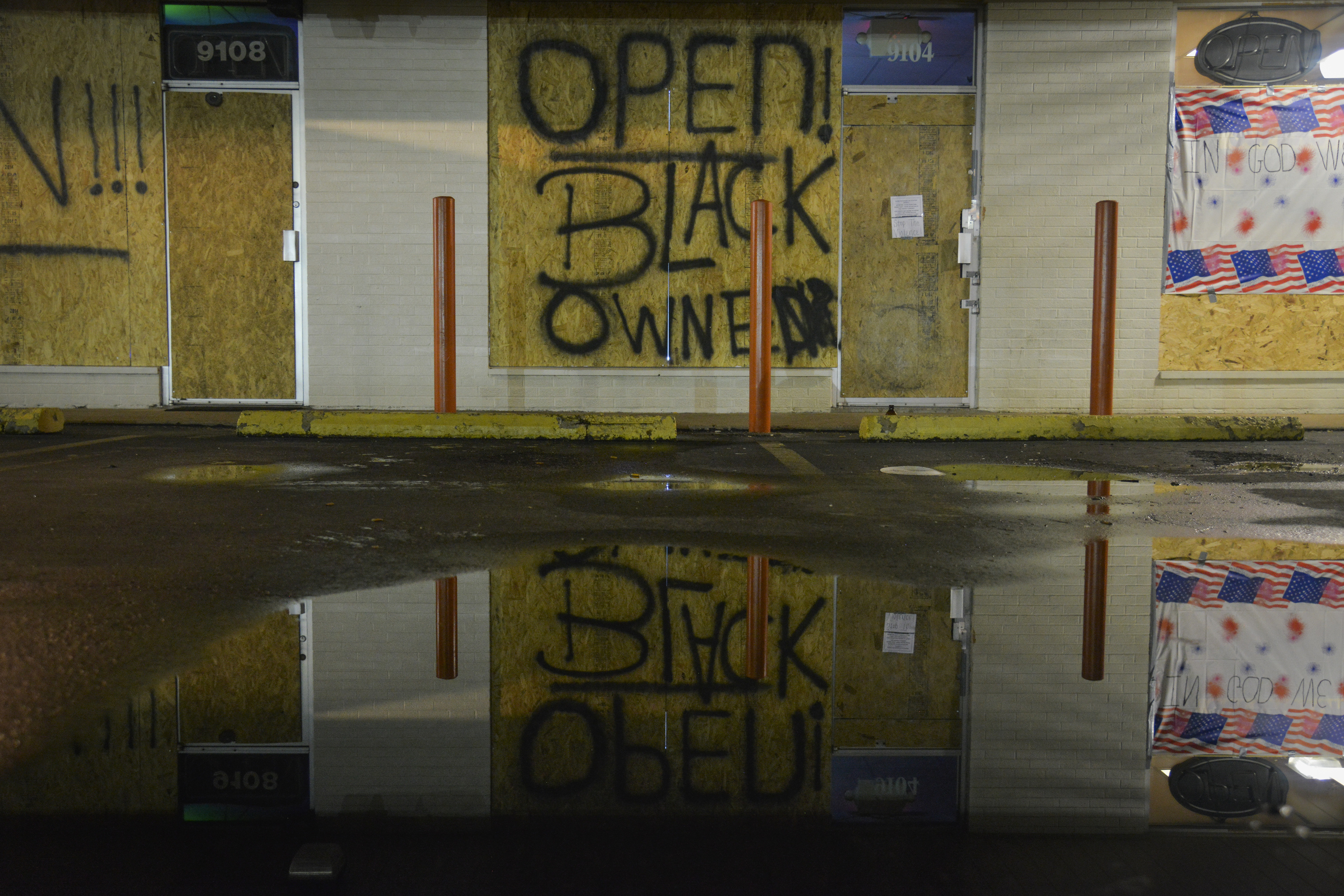 A small clump of businesses are boarded up after a couple of rounds of looting in a community roiled by the police shooting of an unarmed African American teen on Wednesday, August 21, 2014, in Ferguson, MO.