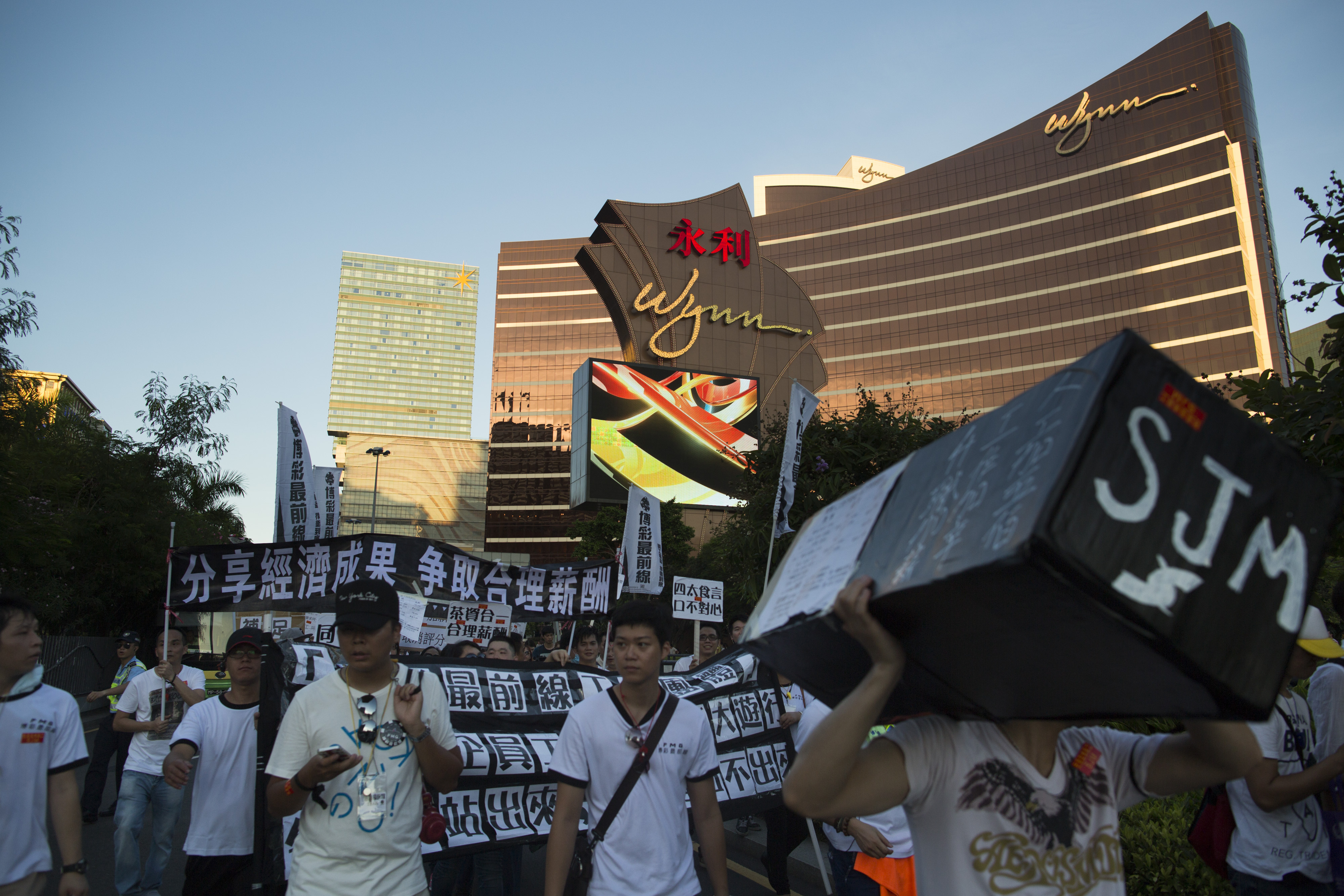 SJM gaming workers protest in front of the Wynn Macau casino resort in Macau on Aug. 25, 2014