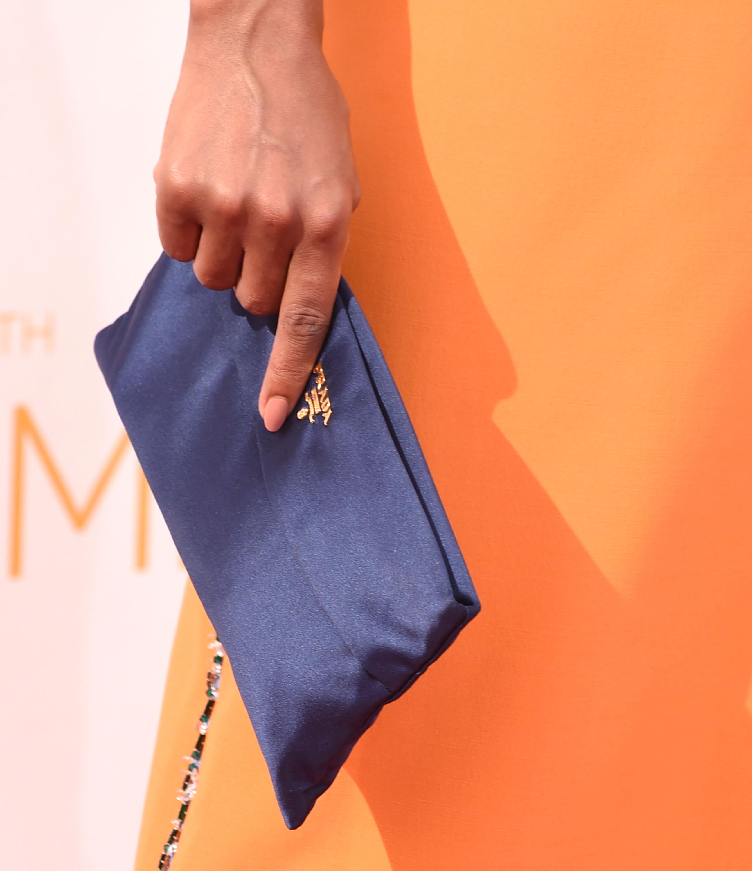 Kerry Washington carries a purple Prada clutch at the 66th Annual Primetime Emmy Awards
