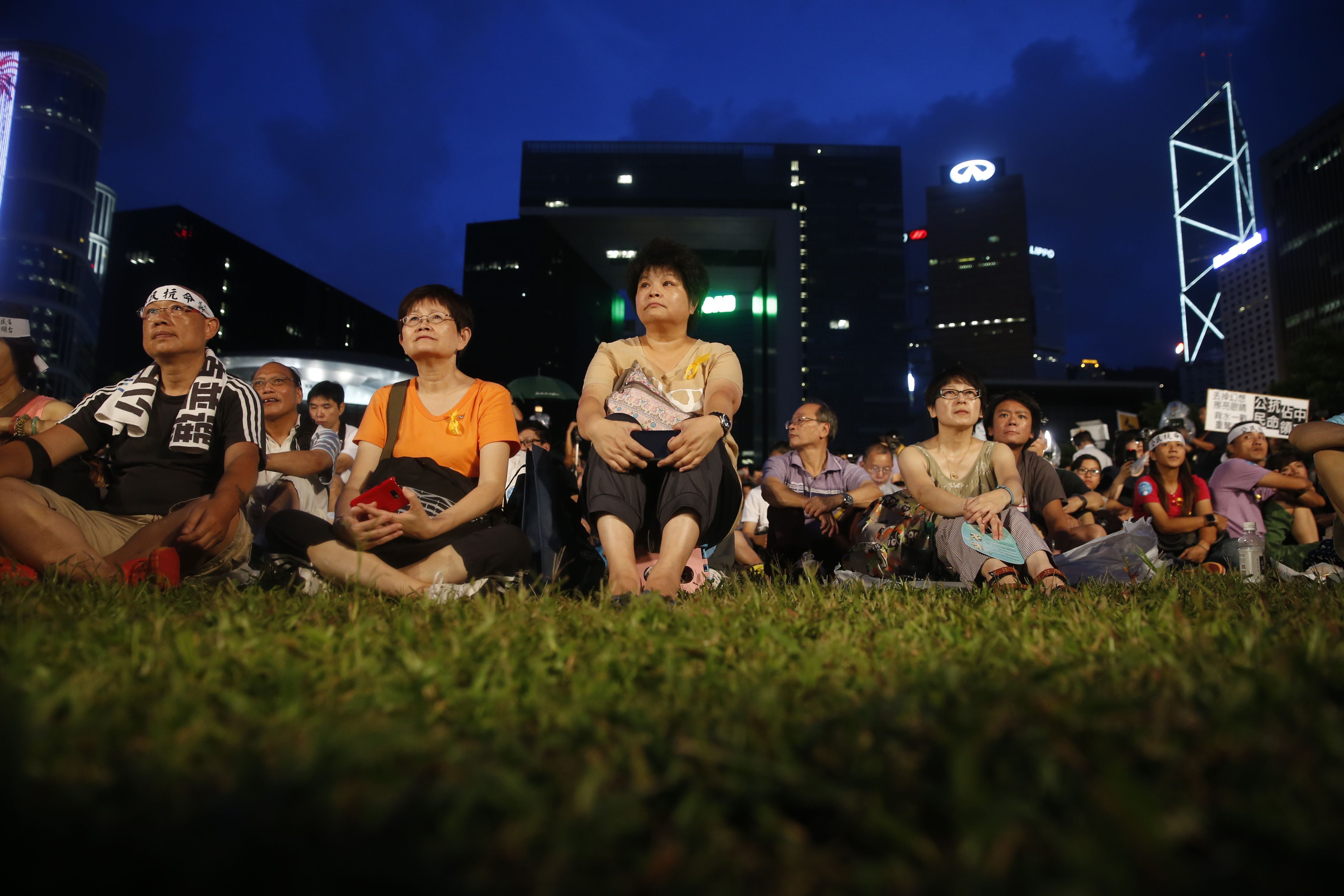 Pro-democracy activists gather during a rally organized by activist group Occupy Central With Love and Peace (OCLP) outside the offices of Chief Executive Leung Chun-ying in Hong Kong, China, on Sunday, Aug. 31, 2014.