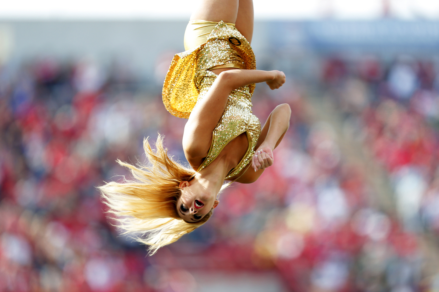 Sept. 1, 2014. A cheerleader for the Edmonton Eskimos goes flying through the air while they played the Calgary Stampeders during their CFL football game at McMahon Stadium in Calgary, Alberta, Canada.