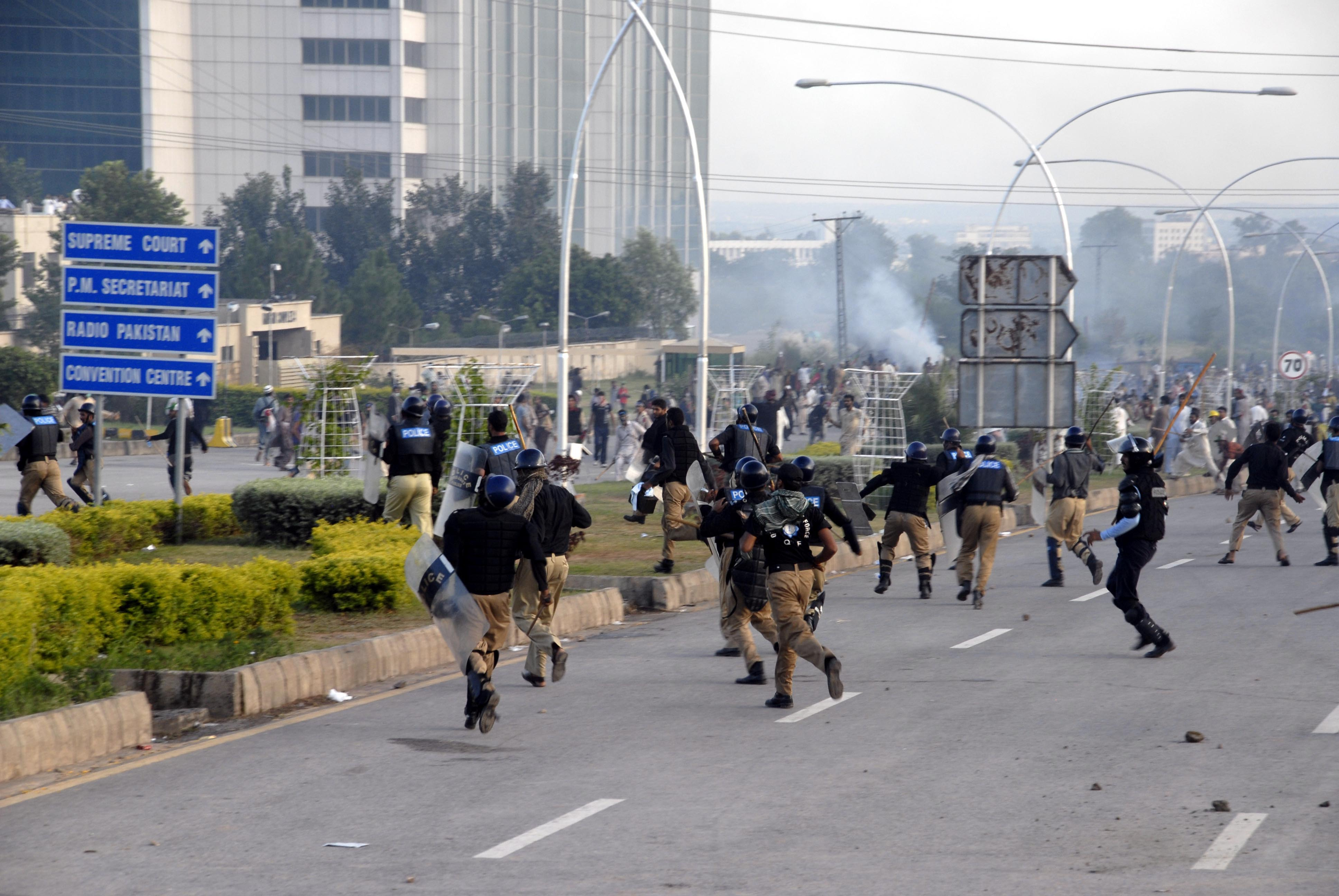 Supporters of Imran Khan and Tahir-ul-Qadri, attack Pakistani security forces during the ongoing anti-government protests in Islamabad. Clashes between the riot police and thousands of anti-government protester continued  which left three people dead and more than 400 wounded.
