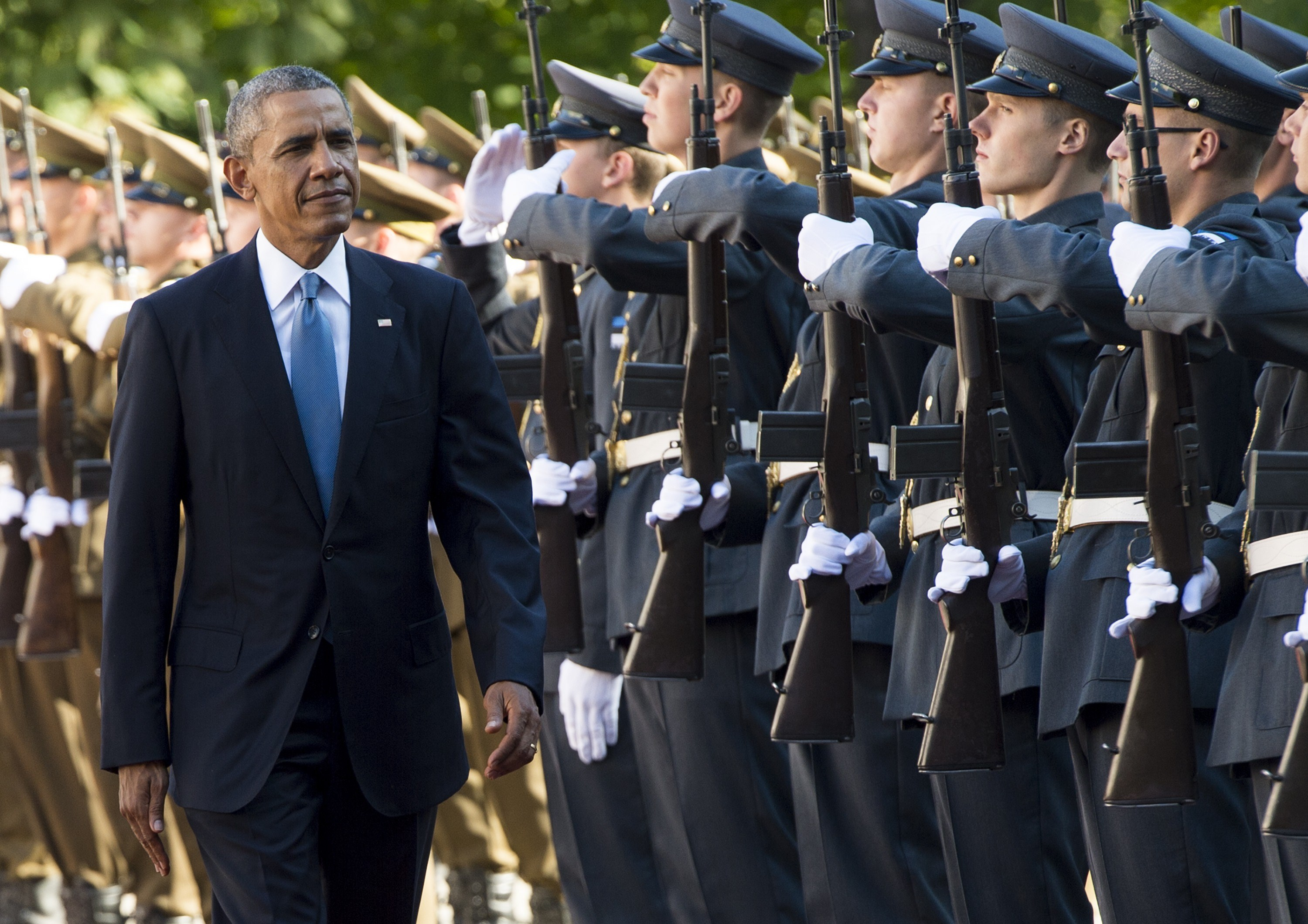 US President Barack Obama and the Estonian President (not in picture) review an honor guard during an arrival ceremony prior to meetings at the Kadriorg Palace in Tallinn, Estonia on Sept. 3, 2014.