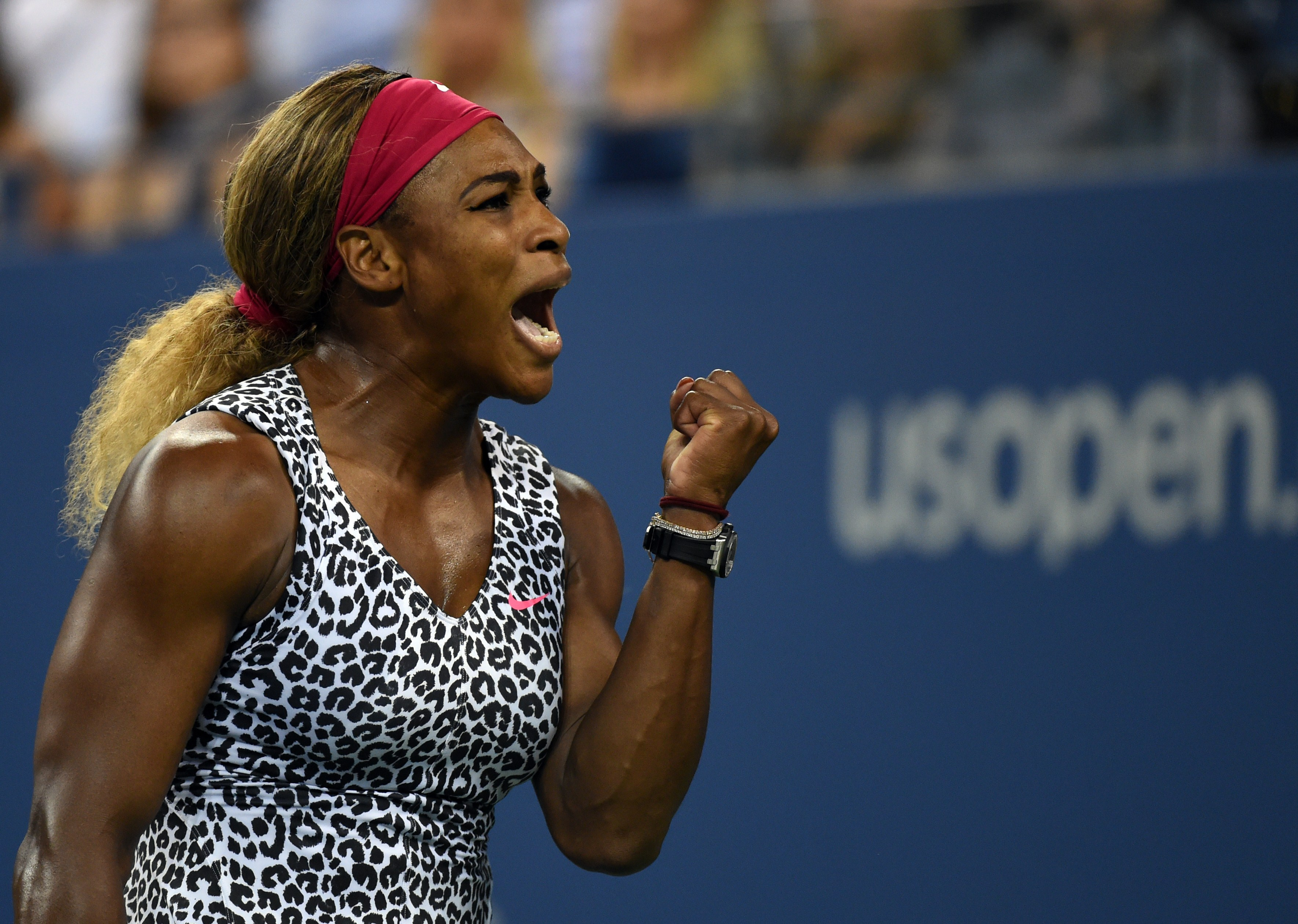 Serena Williams of the US celebrates the first set point against Flavia Pennetta of Italy during their US Open 2014 women's quarterfinals match at the USTA Billie Jean King National Center September 3, 2014  in New York.