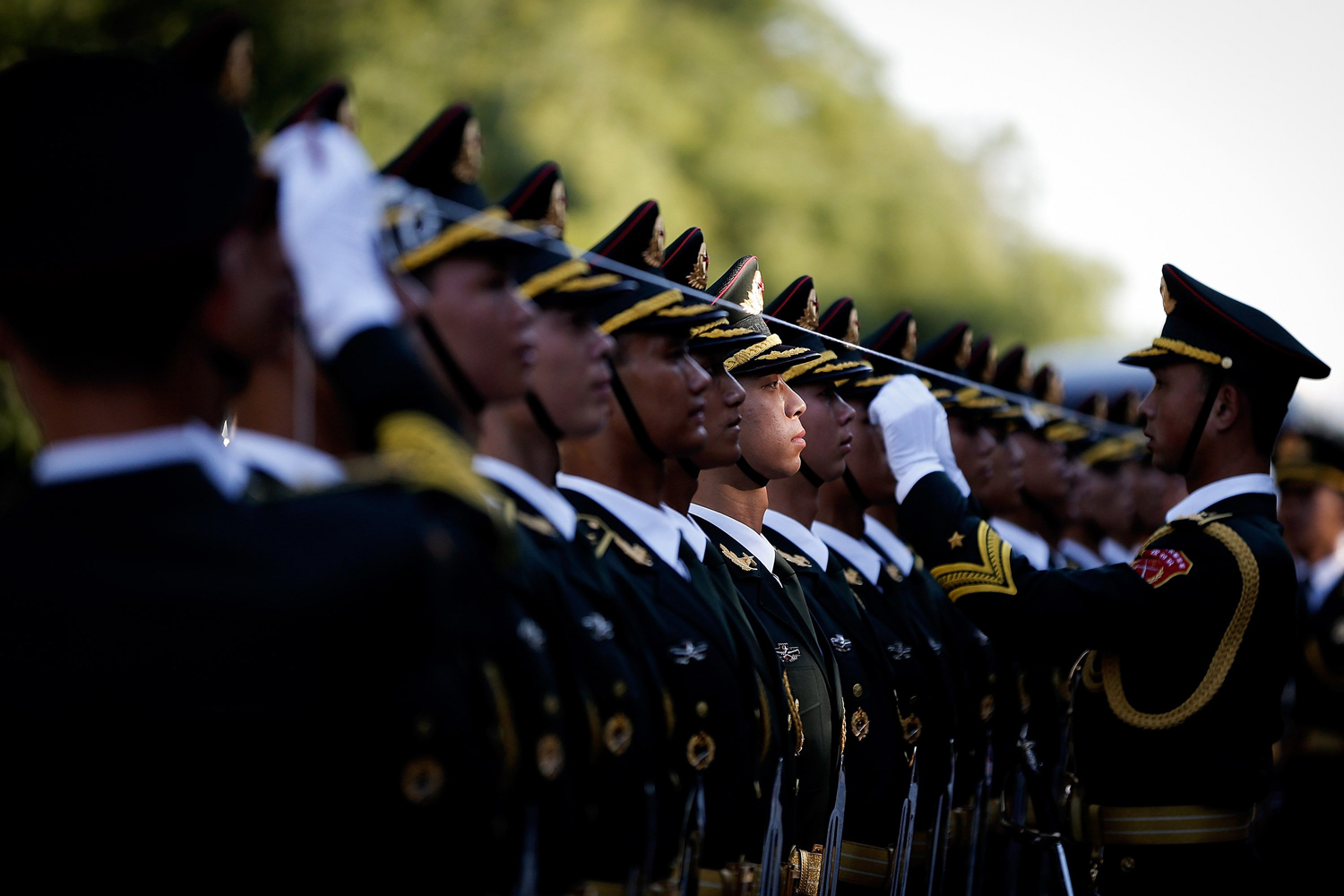 Sept. 4, 2014. Chinese People's Liberation Army soldiers and officer use ropes to measure positions of honor guard members before a welcoming ceremony for Malaysia's Yang di-Pertuan Agong Tuanku Alhaj Abdul Halim Mu'adzam Shah outside the Great Hall of the People in Beijing, China.