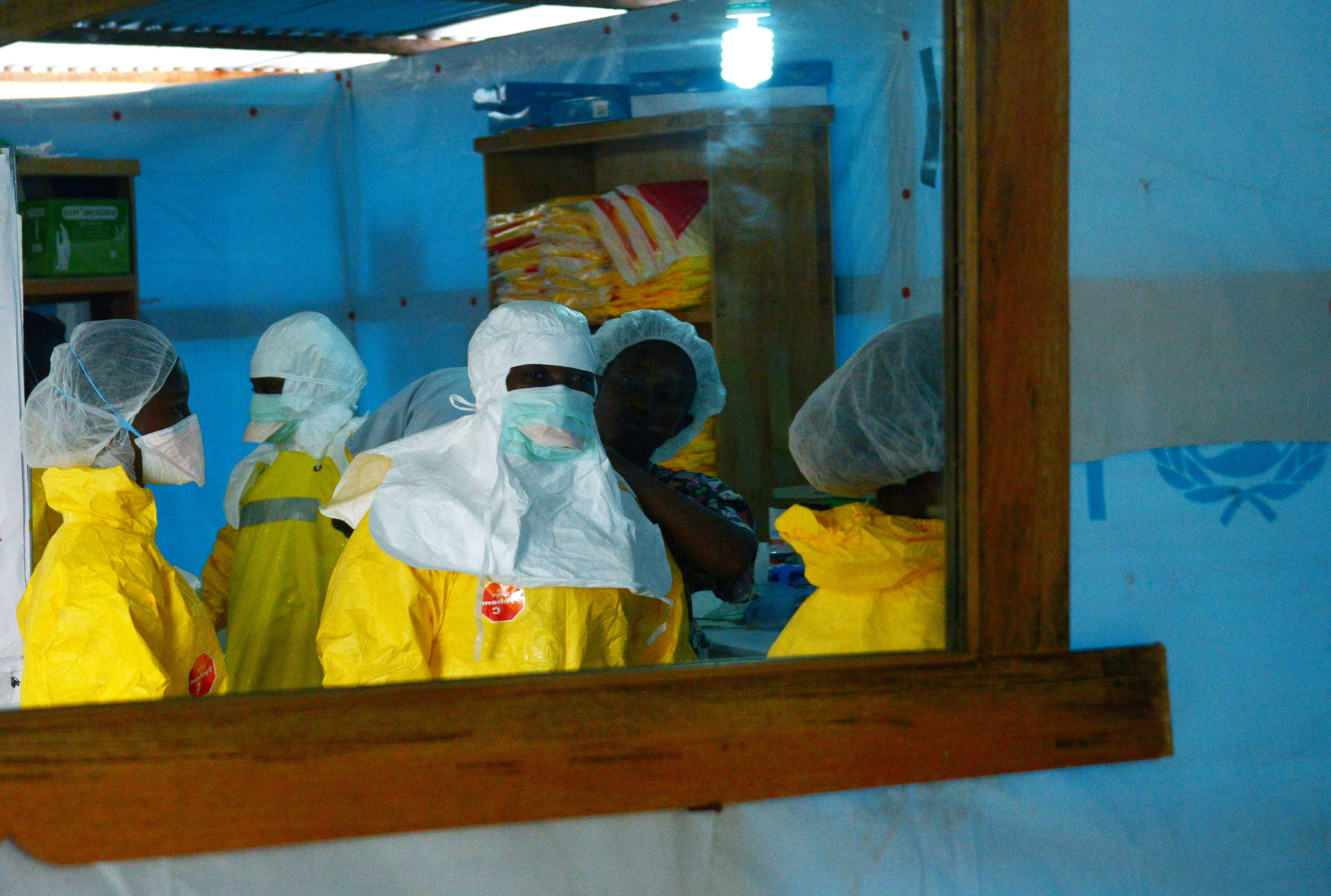 Health workers before entering a high-risk area on Sept. 7, 2014, at Elwa Hospital in Monrovia, Liberia, which is run by Doctors Without Borders