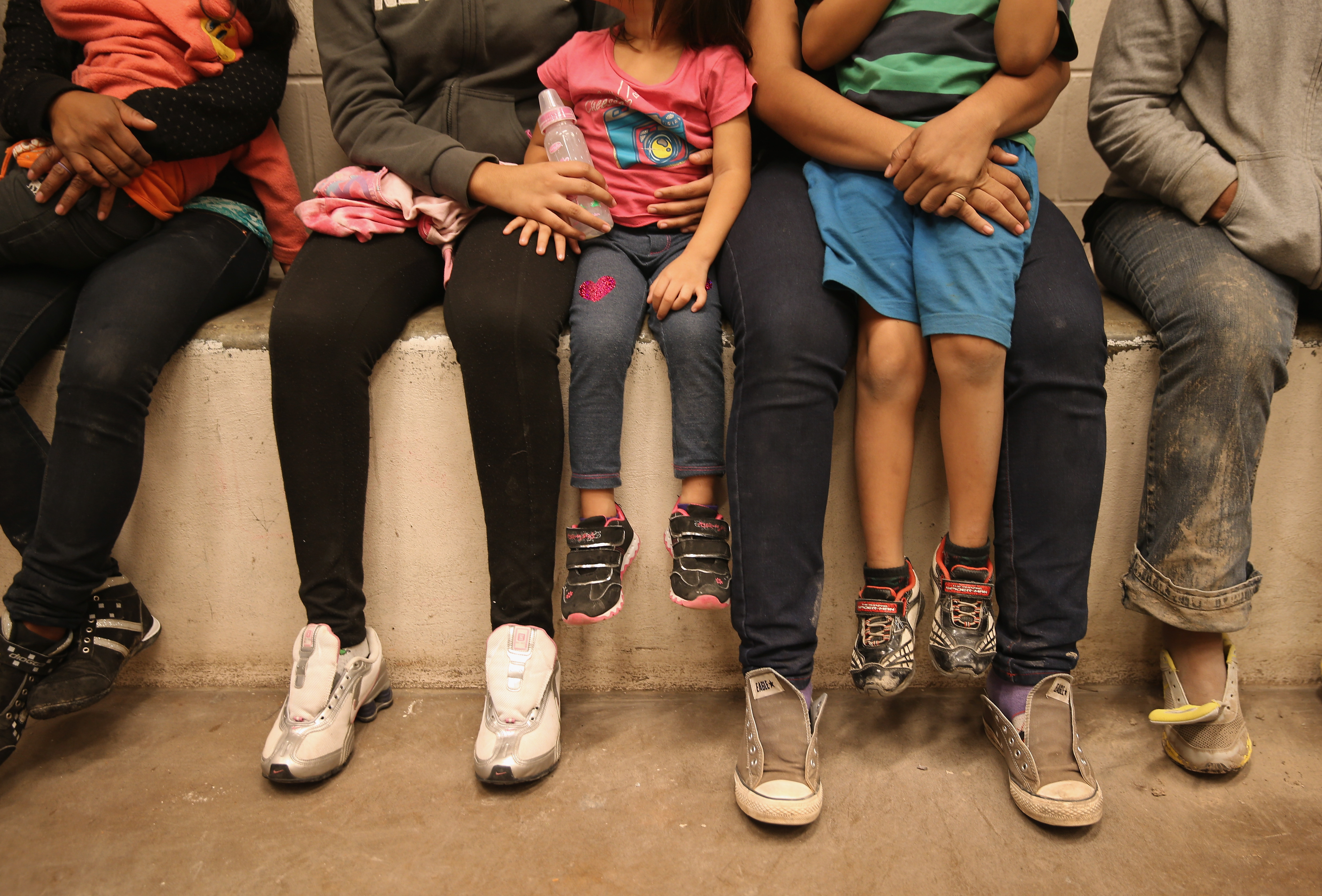 Women and children sit in a holding cell at a U.S. Border Patrol processing center after being detained by agents near the U.S.-Mexico border on September 8, 2014 near McAllen, Texas.