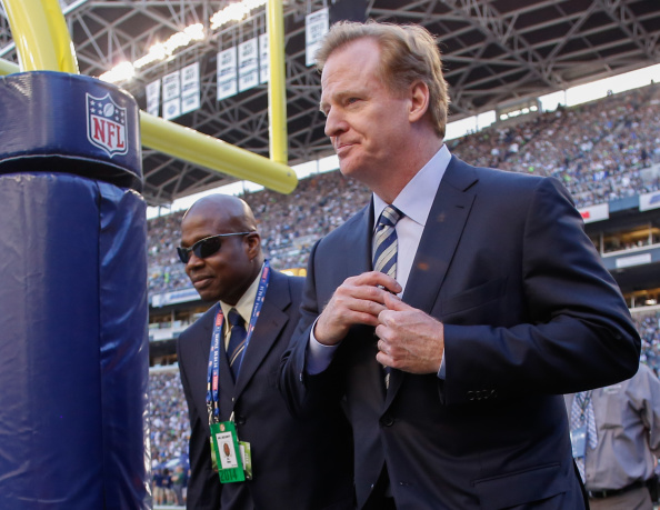 NFL commissioner Roger Goodell (R) walks the sidelines prior to the game between the Seattle Seahawks and the Green Bay Packers at CenturyLink Field on September 4, 2014 in Seattle, Washington.