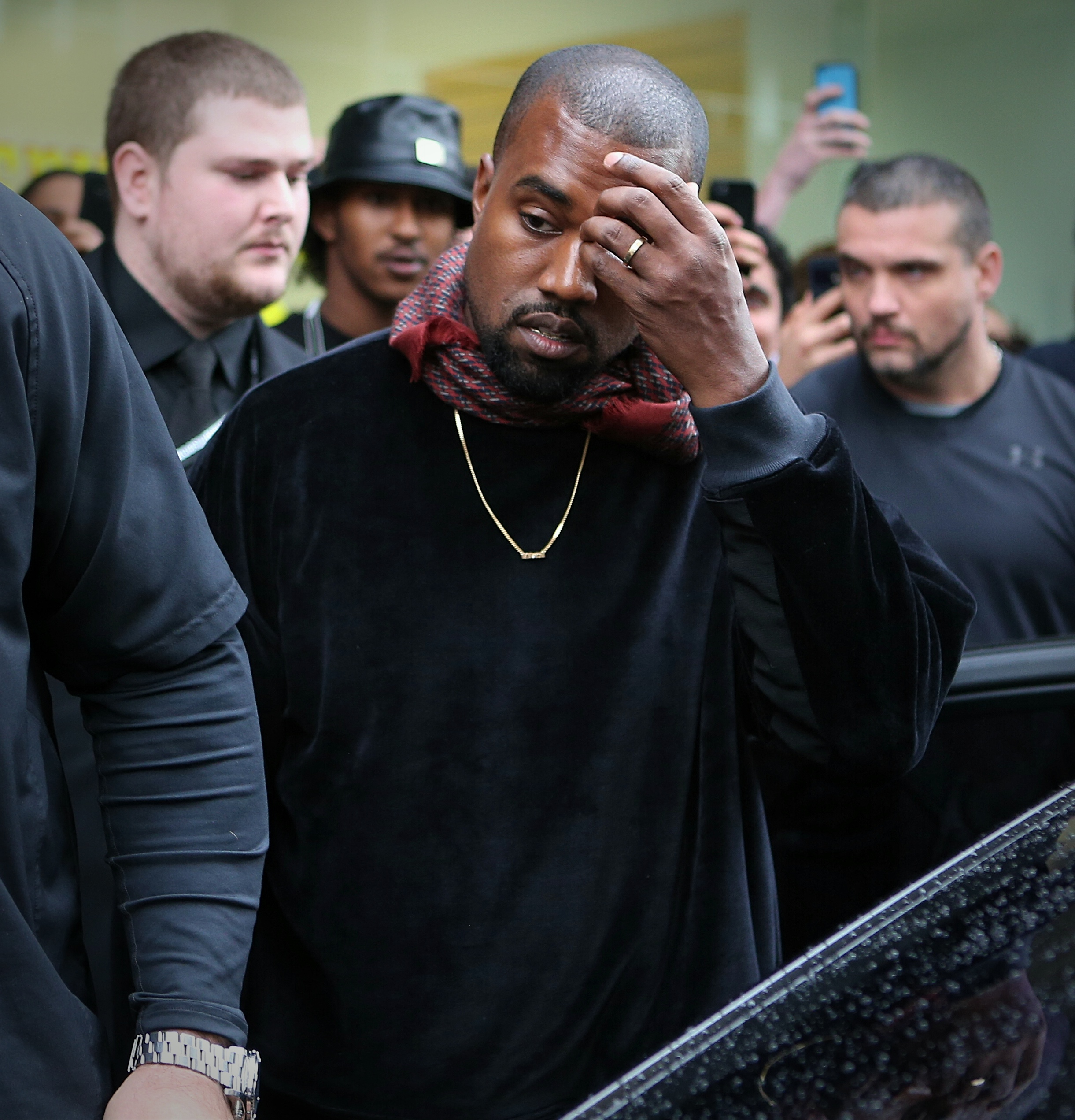 Kanye West leaves his Yeezus pop-up shop in Melbourne on Sept. 9, 2014