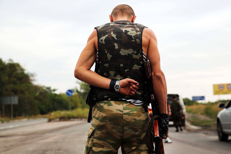 A separatist fighter stands guard on Sept. 10, 2014 in Donetsk, Ukraine.