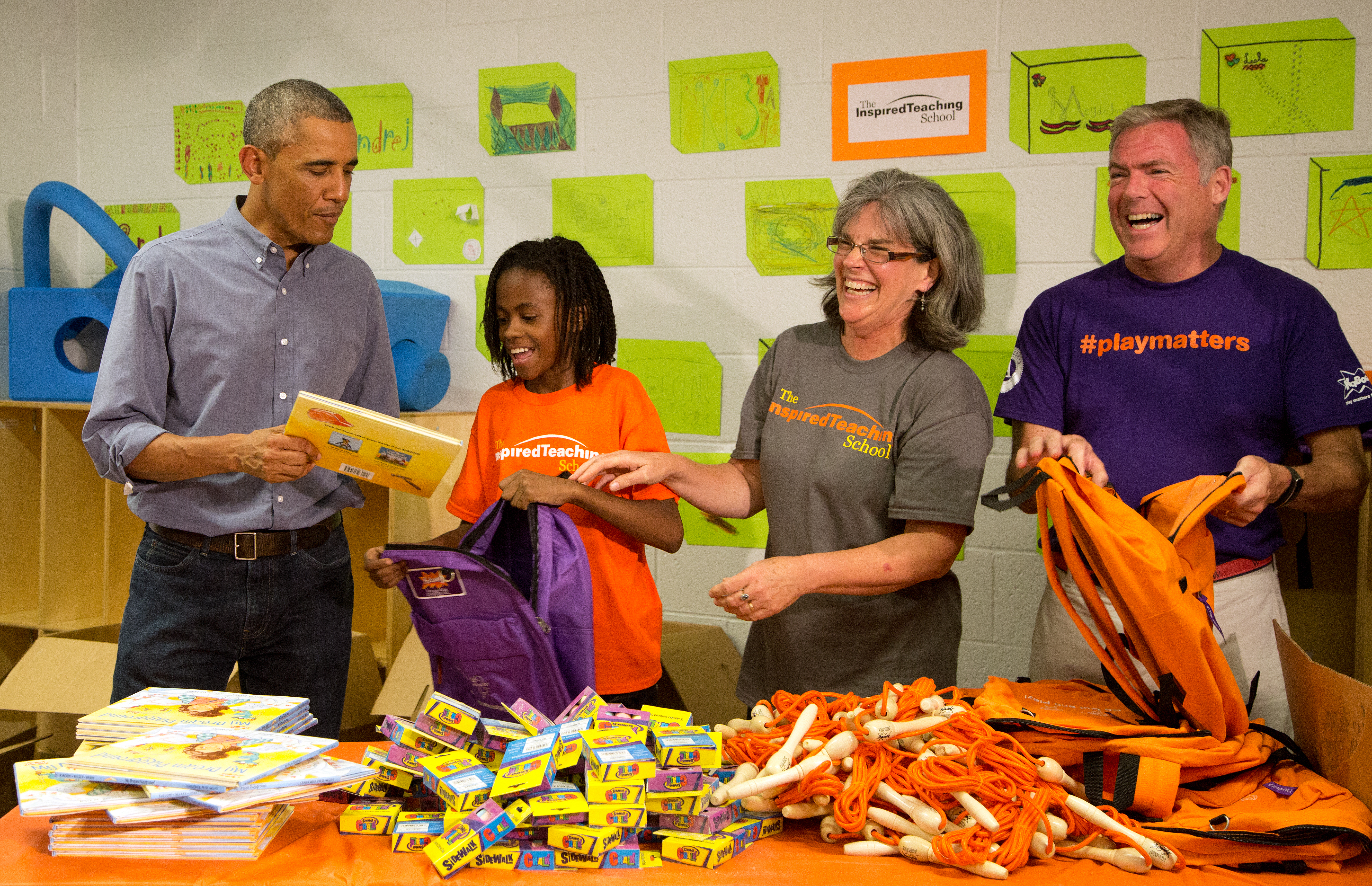 President Barack Obama and volunteers take part in a service project at the Inspired Teaching School in Washington, D.C. on September 11, 2014.