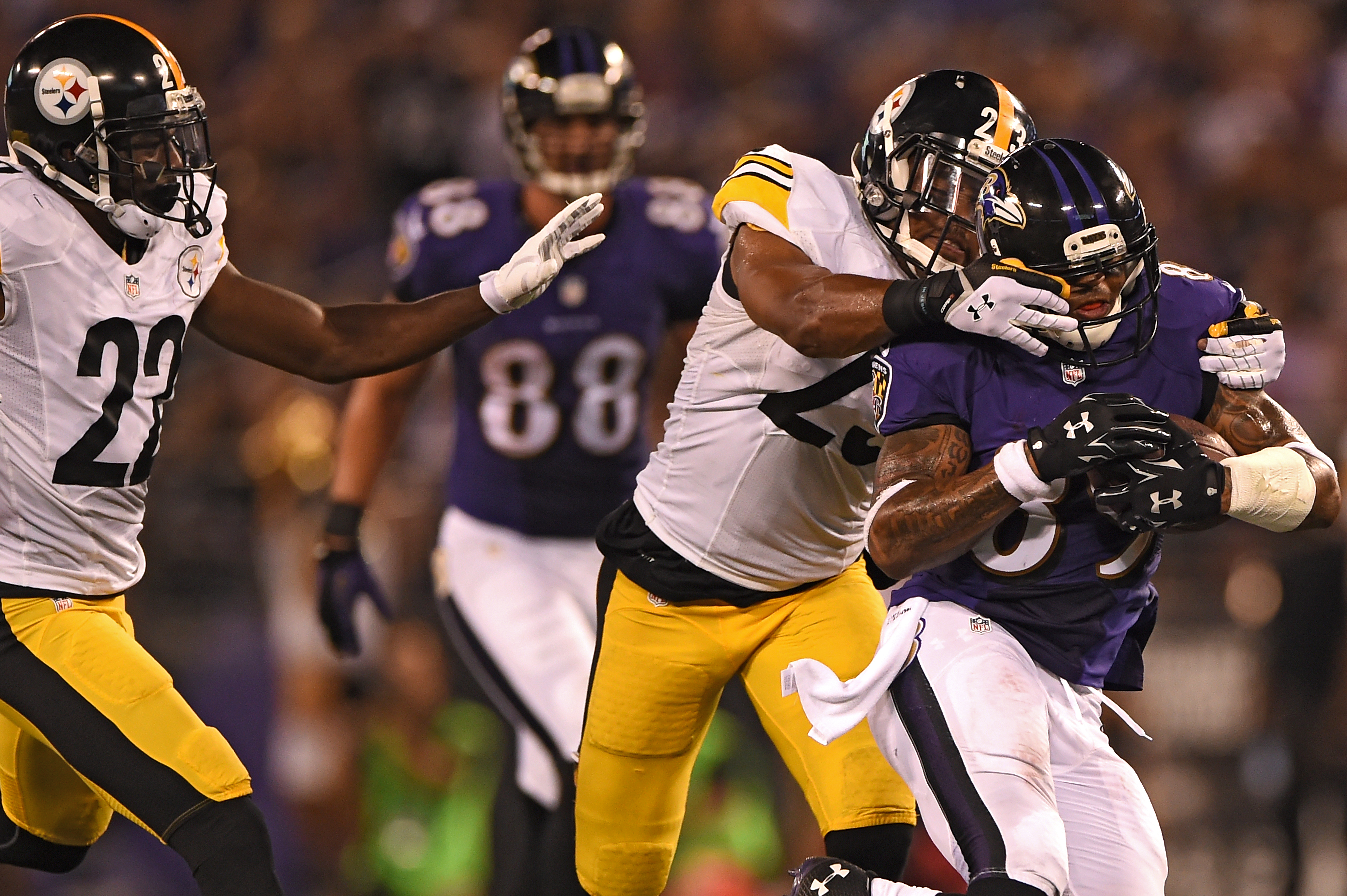 Wide receiver Steve Smith #89 of the Baltimore Ravens is pulled down by the face mask by free safety Mike Mitchell #23 of the Pittsburgh Steelers on September 11, 2014 in Baltimore.