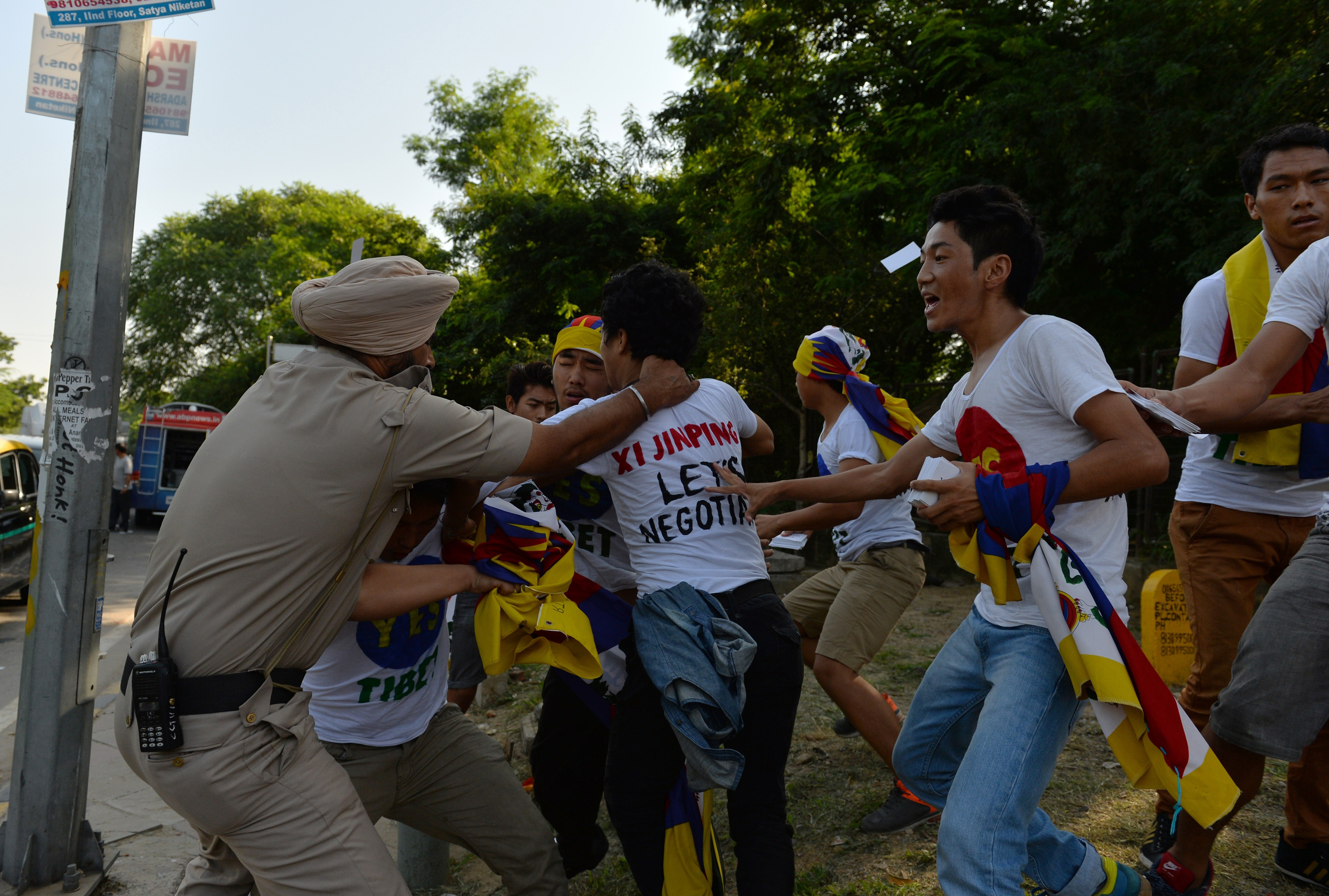 Indian police try to prevent exiled Tibetan youths from advancing as they protest against a visit to India by Chinese President Xi Jinping outside a hotel in New Delhi on Sept. 18, 2014