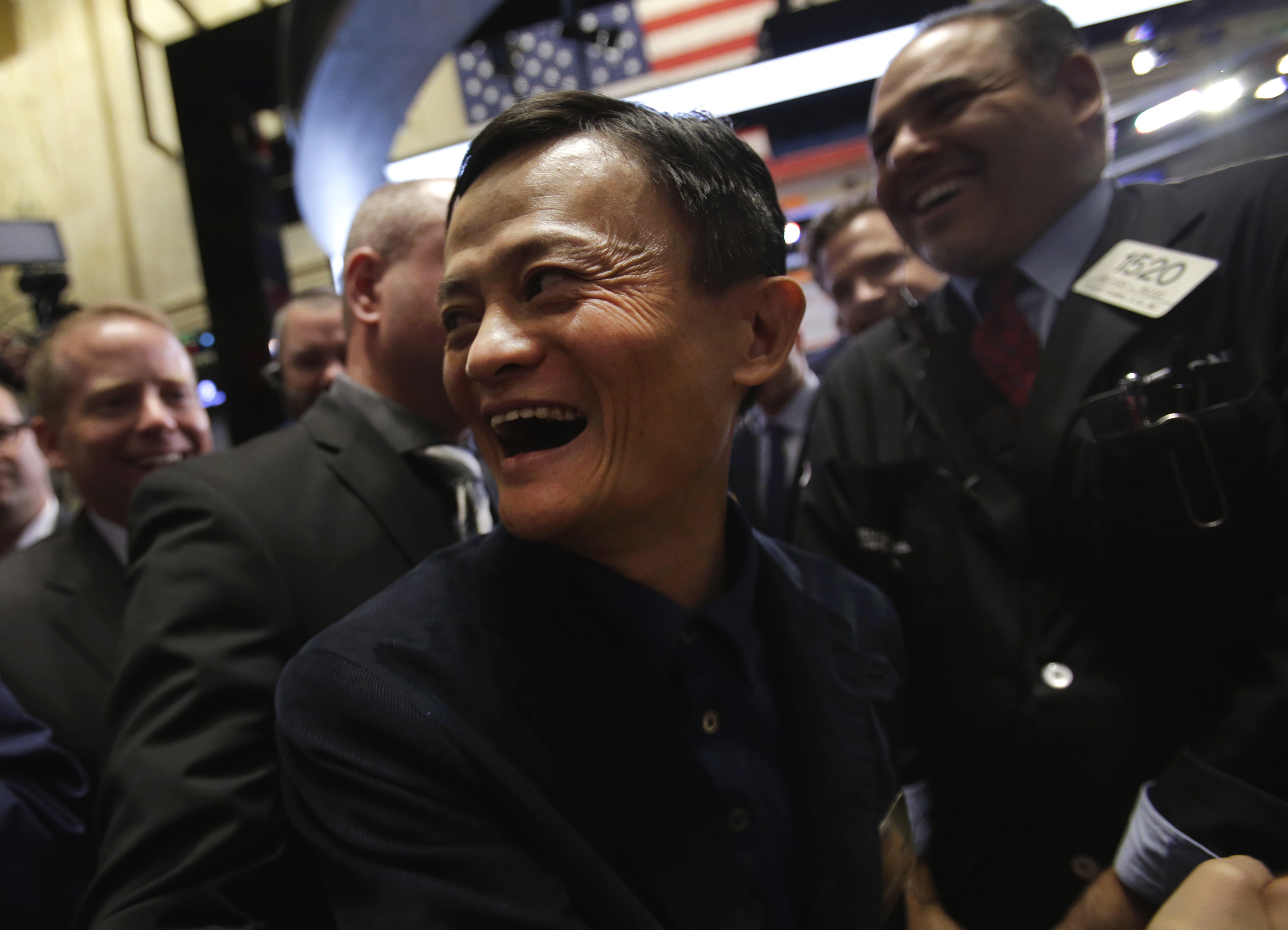 Billionaire Jack Ma, chairman of Alibaba Group Holding Ltd., smiles while touring the floor of the New York Stock Exchange (NYSE) in New York, U.S., on Friday, Sept. 19, 2014.
