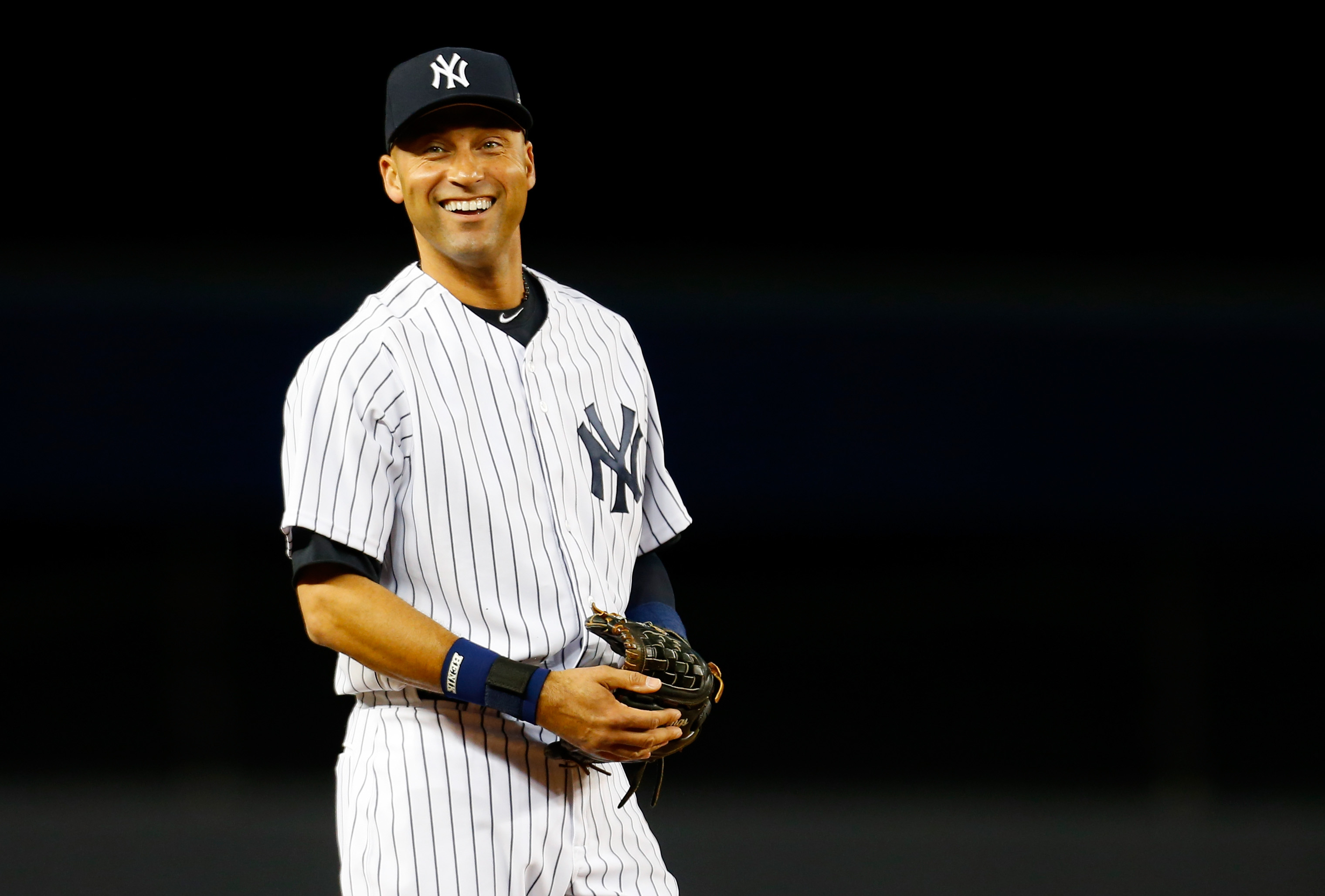 Derek Jeter #2 of the New York Yankees smiles prior to a game against the Baltimore Orioles at Yankee Stadium on September 22, 2014.