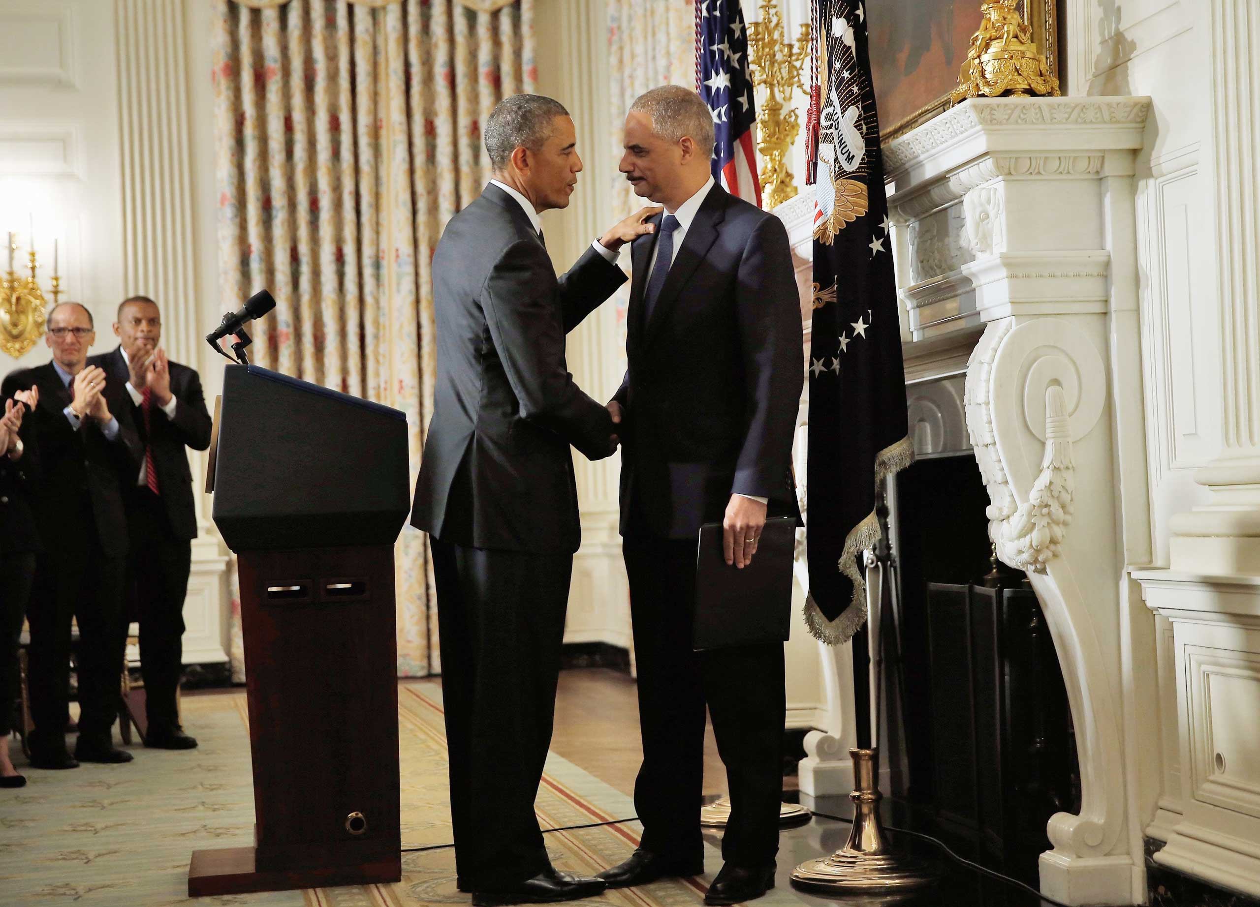President Barack Obama shakes hands with Attorney General Eric H. Holder Jr. who announced his resignation today, Sept. 25, 2014 in Washington, DC.