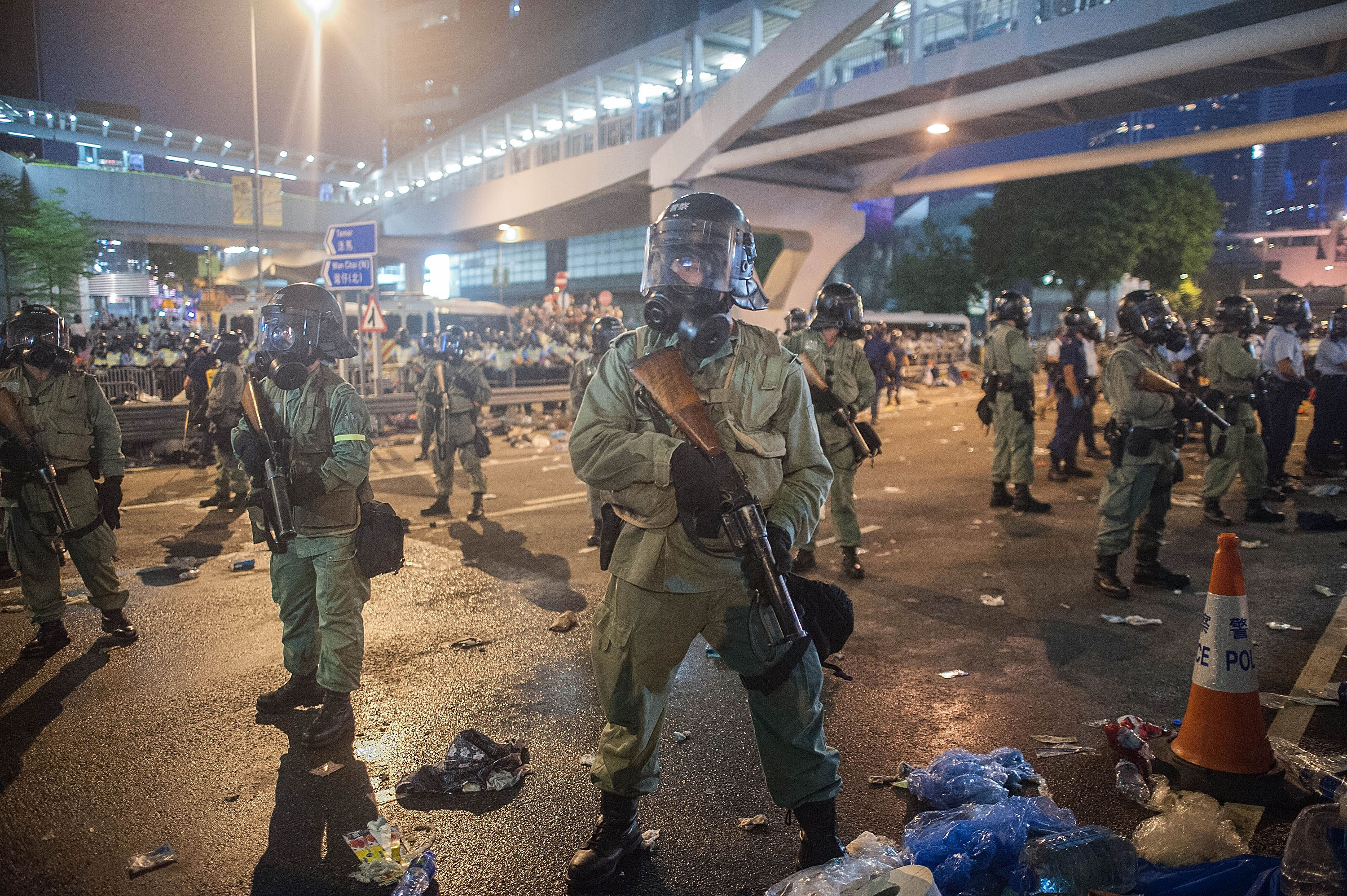 Riot police stand guard outside Hong Kong Government buildings on September 28, 2014 in Hong Kong.