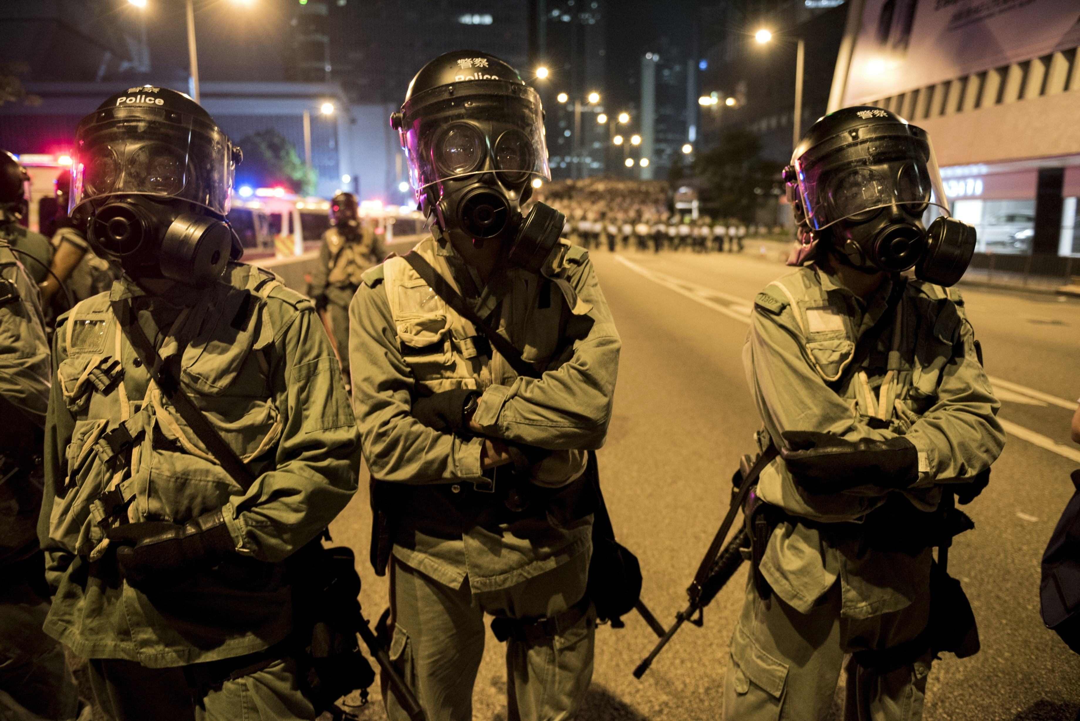 Police officers face off with pro-democracy protesters in Hong Kong on Sept. 28, 2014