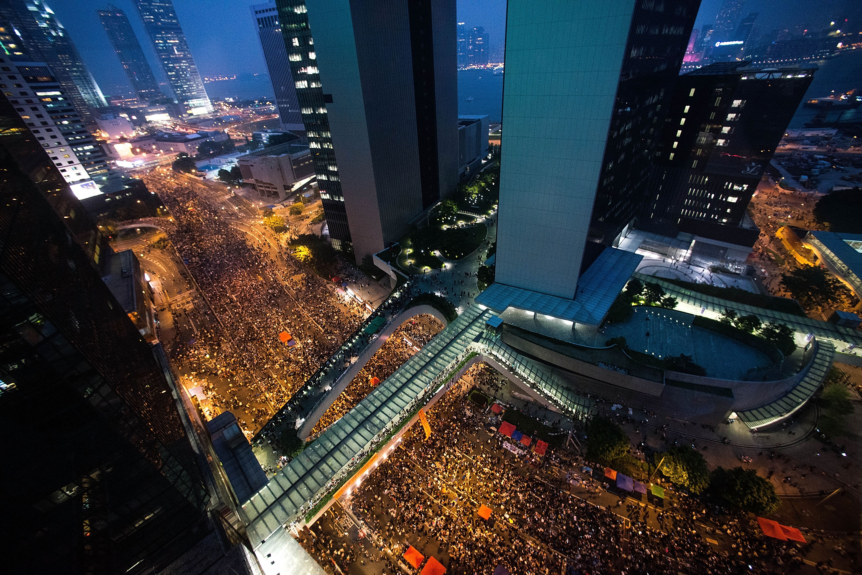 Protesters take part in a rally on a street  outside of the Hong Kong government complex in Hong Kong on Sept. 30, 2014