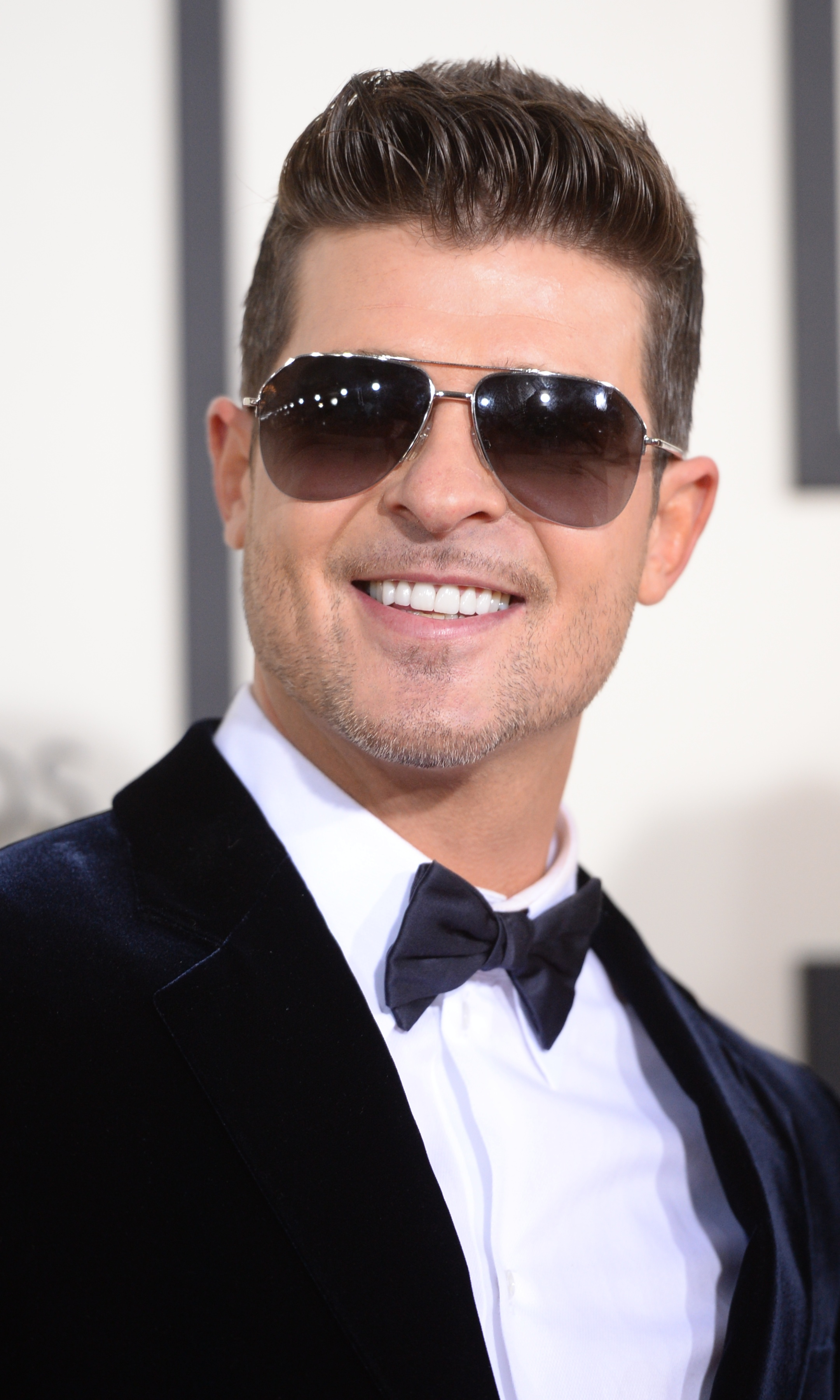 Robin Thicke arrives on the red carpet for the 56th Grammy Awards in Los Angeles on Jan. 26, 2014