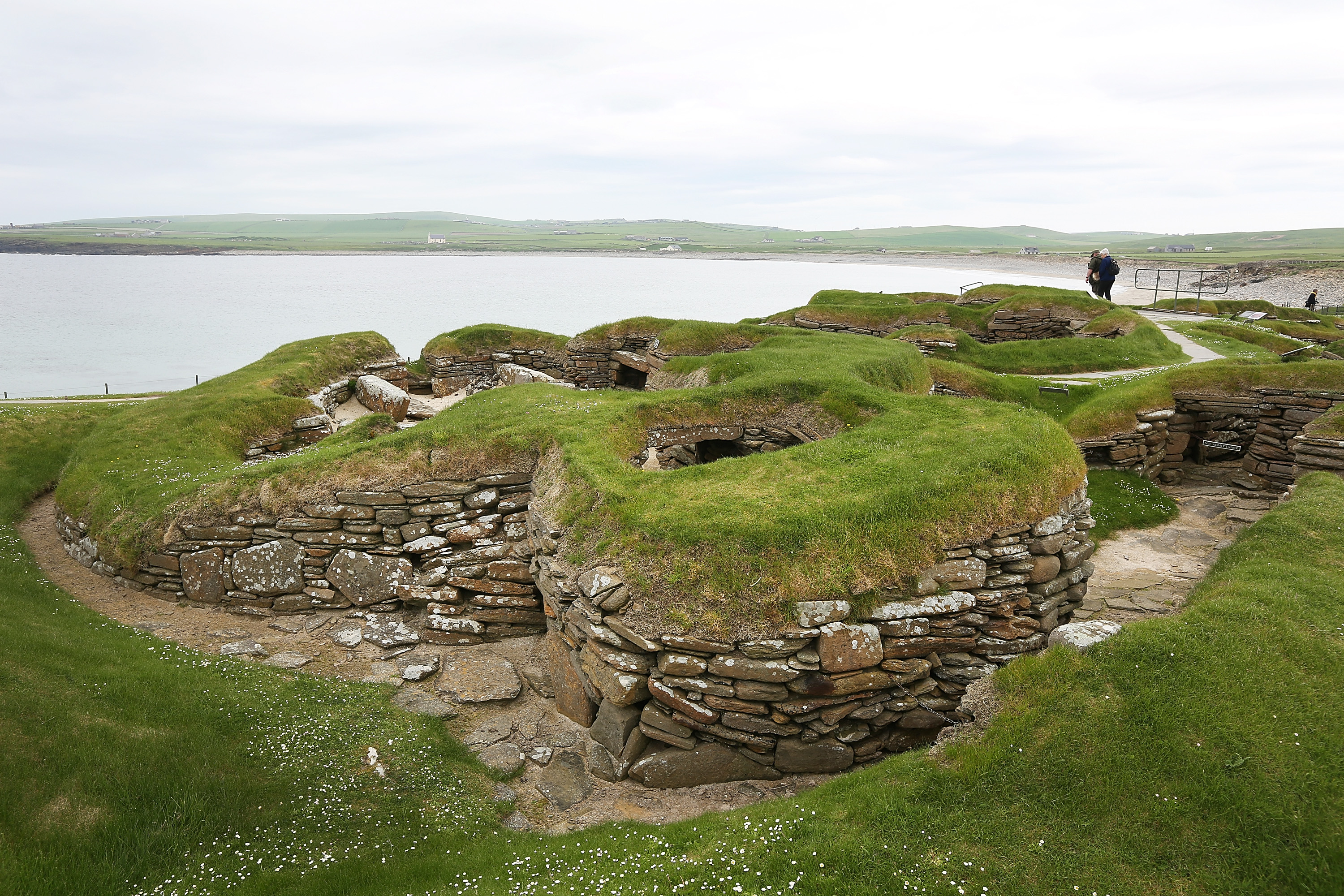 Houses of the Neolithic settlement of Skara Brae, on June 1, 2014 in Bay of Skaill, Scotland. The Skara Brae settlement was discovered in 1850 and is one of the most important prehistoric sites on the Orkney, showing how people lived approximately 5,000 years ago.