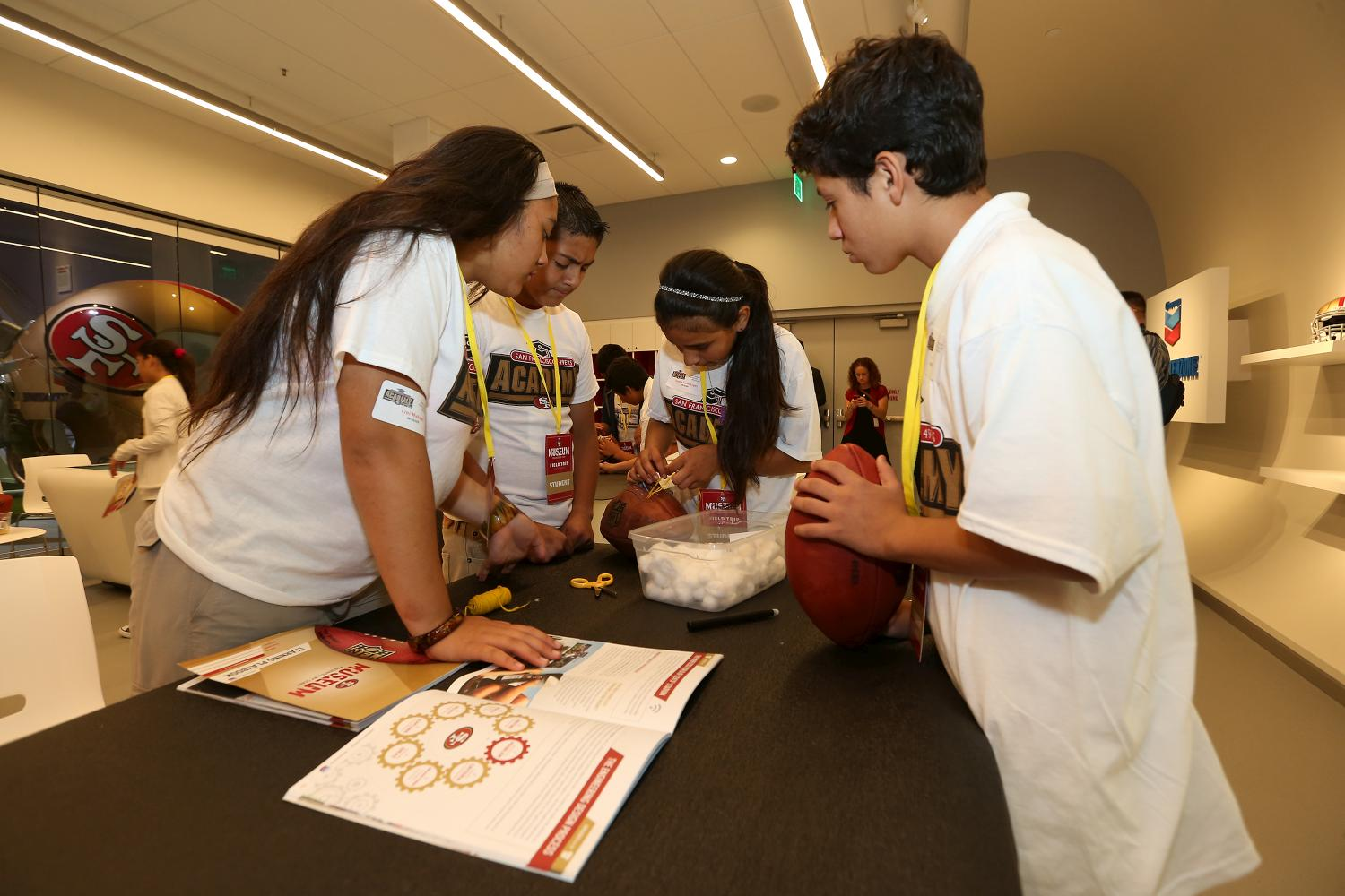 Students assemble a football at the 49ers STEM Leadership Institute at Levi's Stadium