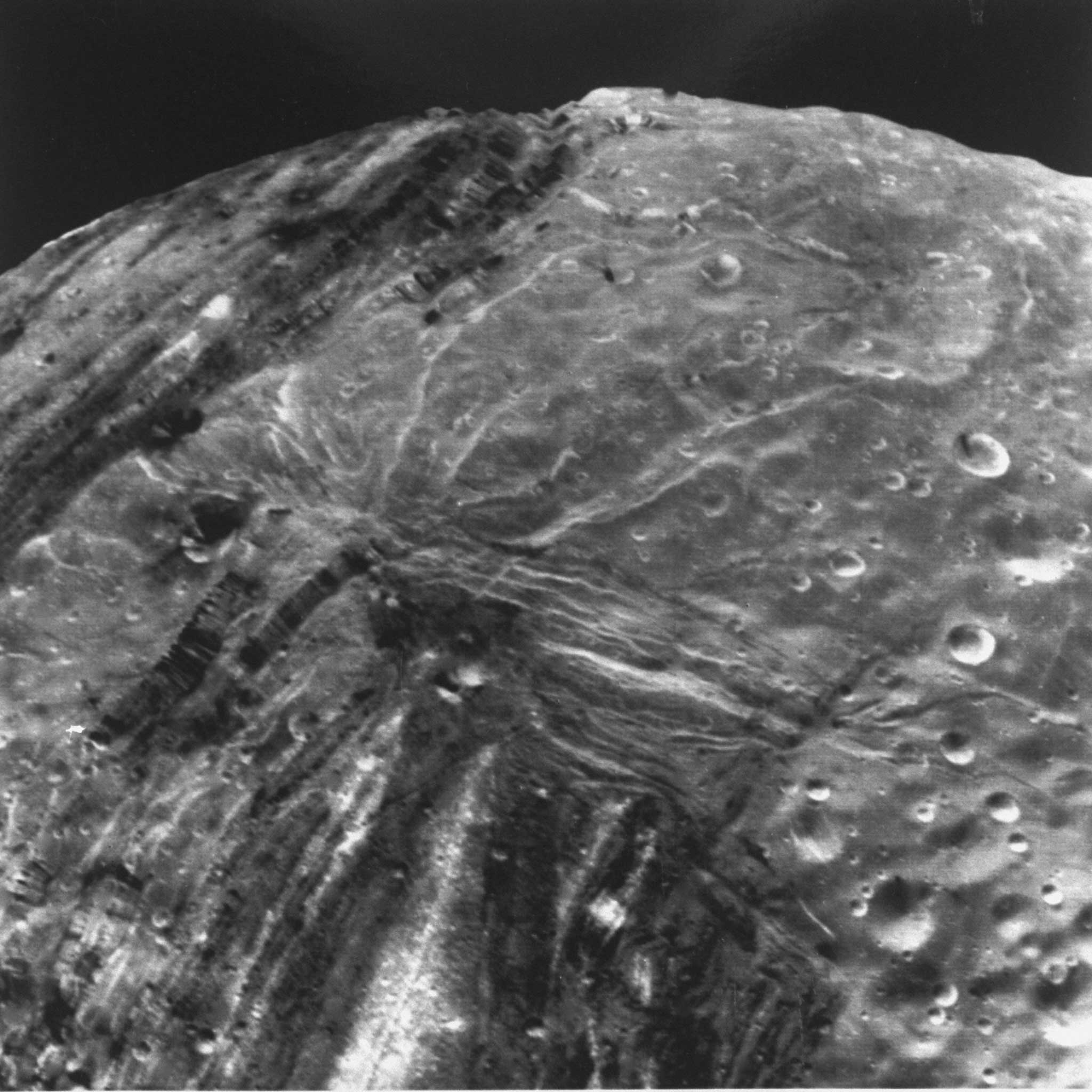 High-resolution image of the surface of Miranda, one of Uranus' largest moons, taken from the Voyager 2 spacecraft