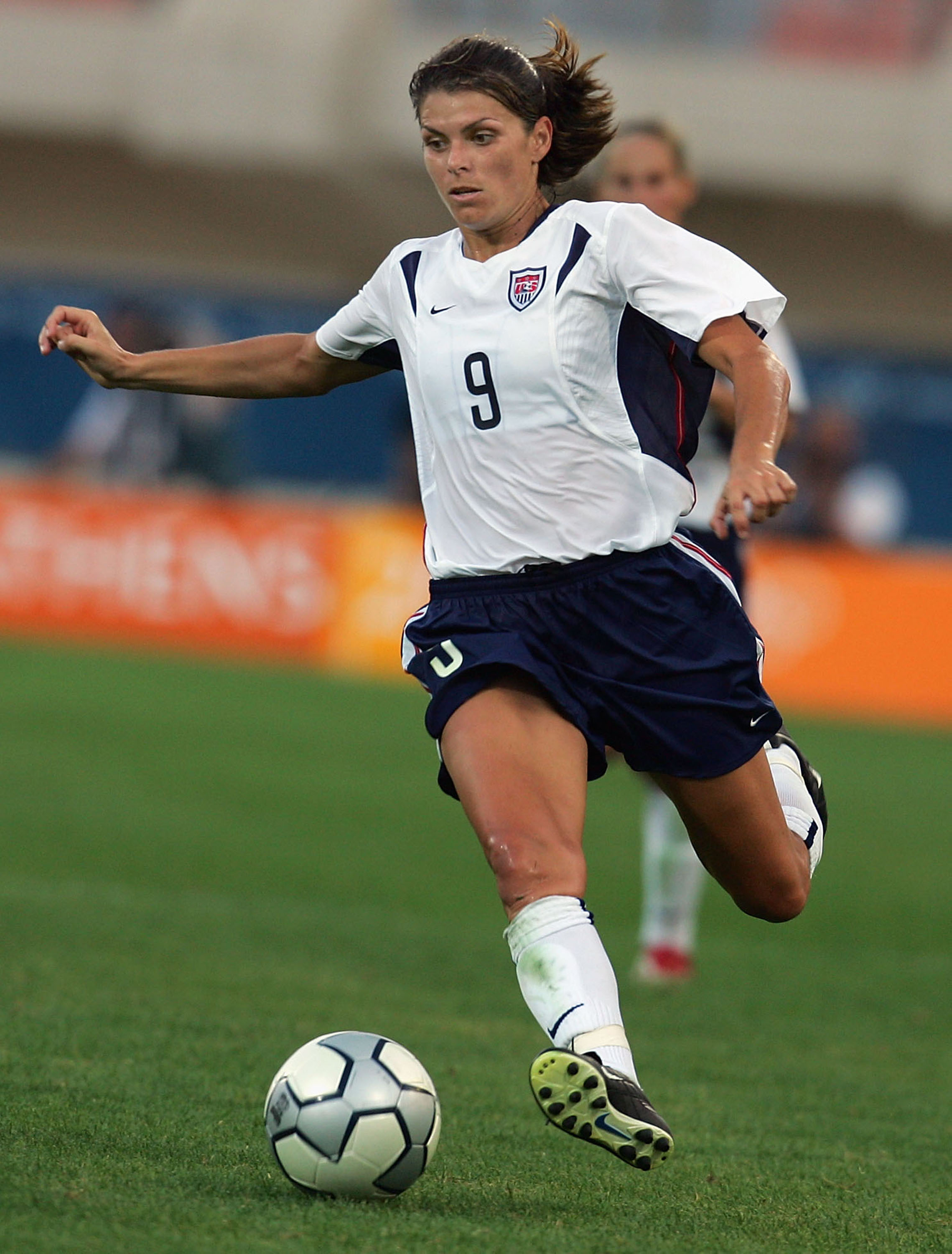 Mia Hamm #9 of the United States dribbles during the women's soccer semifinal match between USA and Germany on August 23, 2004 during the Athens 2004 Summer Olympic Games at Pankritio Stadium in Heraklio, Greece.