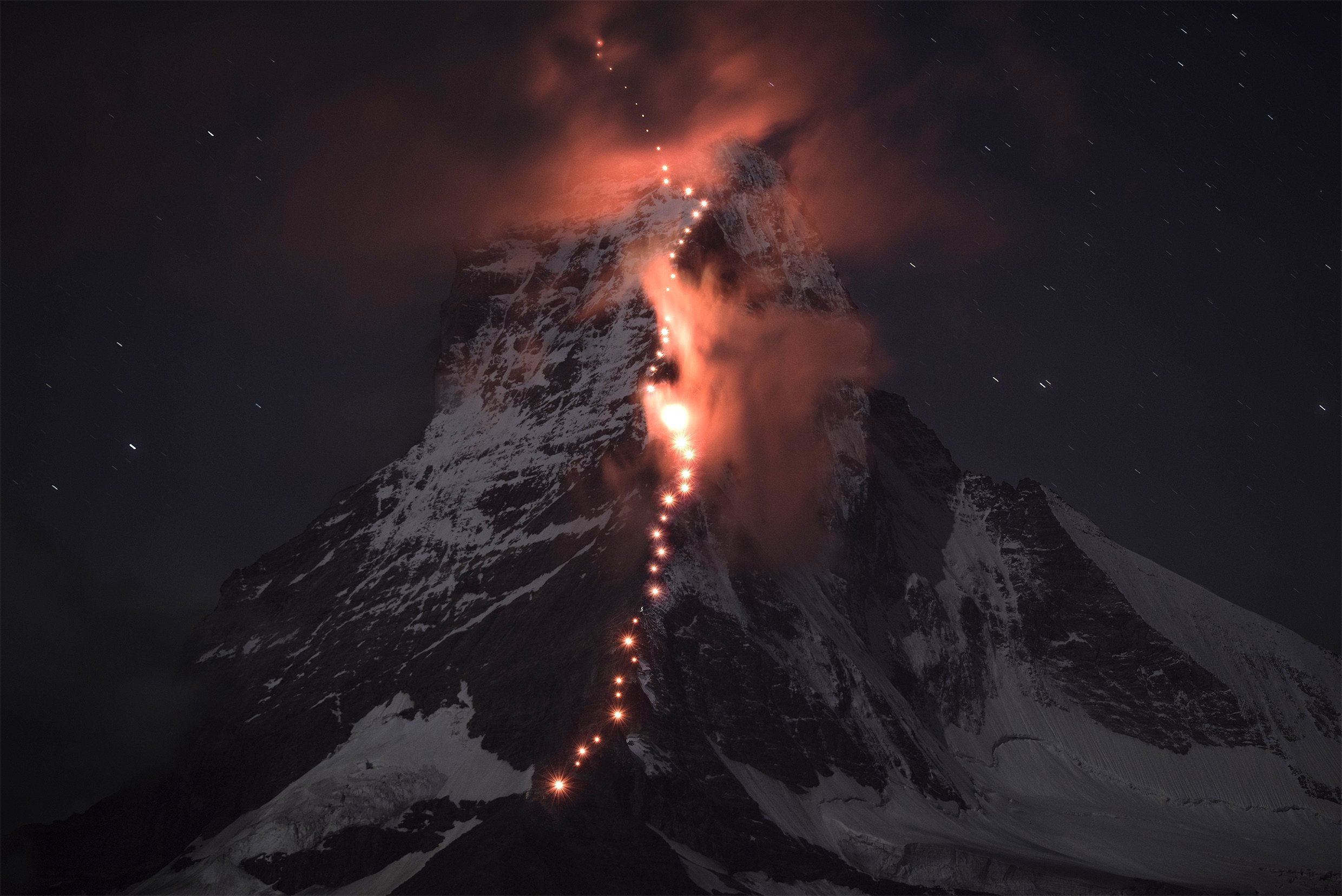 In preparation for the 150th anniversary of the first ascent of the Matterhorn, Swiss mountain sports specialist Mammut and mountain guides from the village of Zermatt transformed the spectacular summit into a shining stone icon as an anniversary gift to Zermatt on Sept. 16, 2014.