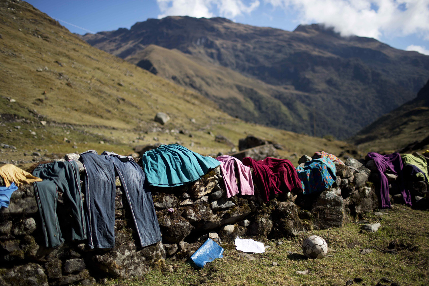 Sept. 2, 2014. Villagers dry their clothes on a stone wall in the mountain village of Chupon, Peru. The village lies in the Peruvian Andes in the province of Ayacucho and houses about 30 peasants that subsist on farming corn and potatoes.