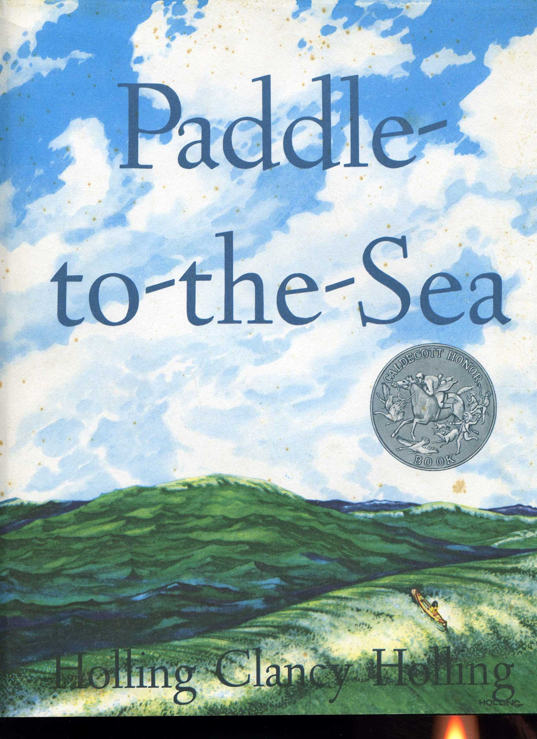 Paddle-to-the-Sea, by Holling Clancy Holling.                                                                                                                            A young boy carves a figure in a small canoe and sends him on a journey from the Great Lakes to the Atlantic Ocean.                                                                                                                            Buy now: Paddle-to-the-Sea