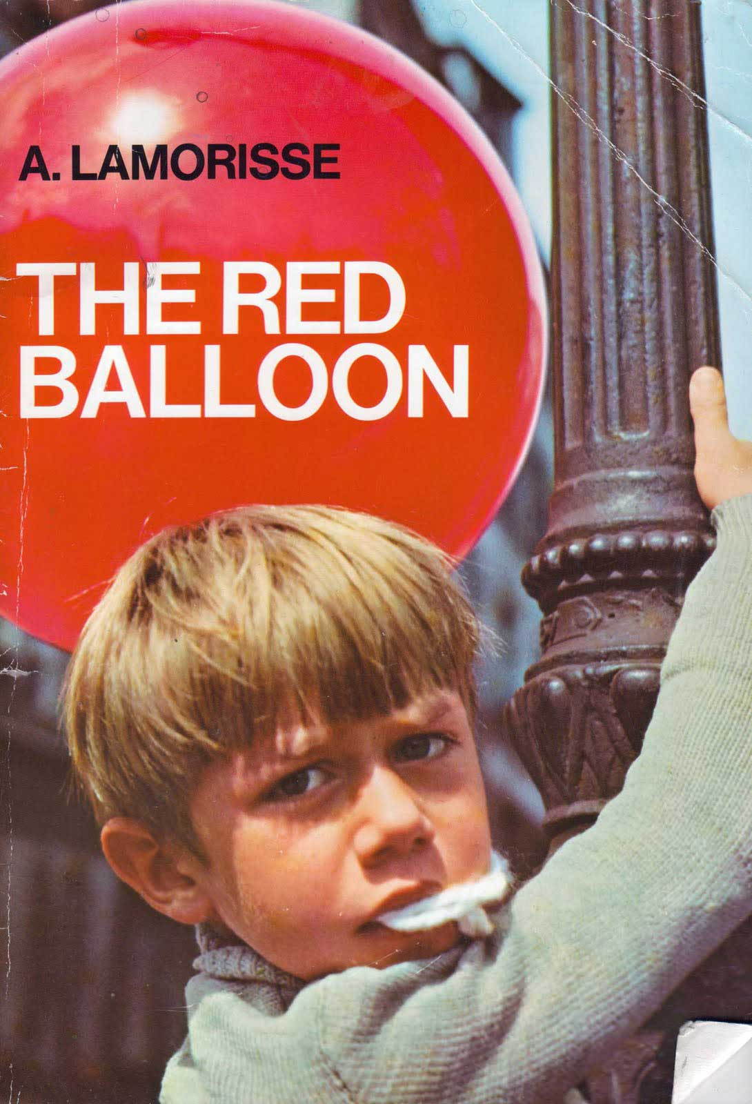 The Red Balloon, by Albert Lamorisse.                                                                                                                            Vivid photographs help tell this story about a boy in Paris and his best friend, a red balloon.                                                                                                                            Buy now: The Red Balloon