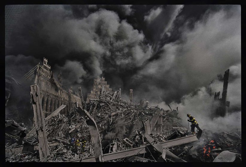 """MaryAnne Golon, photo editor and media consultant; former Director of Photography of TIME """"James NachtweyÕs photograph here of one tiny New York City fireman making his way through the inferno that was once the World Trade Center towers is forever seared into my memory from the darkest day in American history, 9/11/2001. Later on that evening, Jim, completely covered in ash from the fallen World Trade Center towers, arrived in person at the Time and Life building in midtown Manhattan to deliver his exposed film to his waiting editors. While his film was being processed, he drank a large bottle of water, and slumped exhausted in a dark green chair in the Time photo department hallway. The following morning, the imprint of his body on the chair and his dusty footprints were still there. Then editor-in-chief Norman Pearlstine and his deputy, John Huey, came by to see where the great photographer had walked. James Kelly, the finest news magazine editor in America, chose to run many of JimÕs pictures in the 9/11 black-bordered issue of TIME Magazine that memorialized that tragic event. I was honored to have been the picture editor of that edition and to be the first person in the world to have seen JimÕs haunting work. It took months for me to grieve as a human being. I was working 80-hour weeks to do my job as a journalist. JimÕs work comforted me and helped many Americans to process the hideous aftermath of those horrendous days. Thank you, Jim Nachtwey."""""""