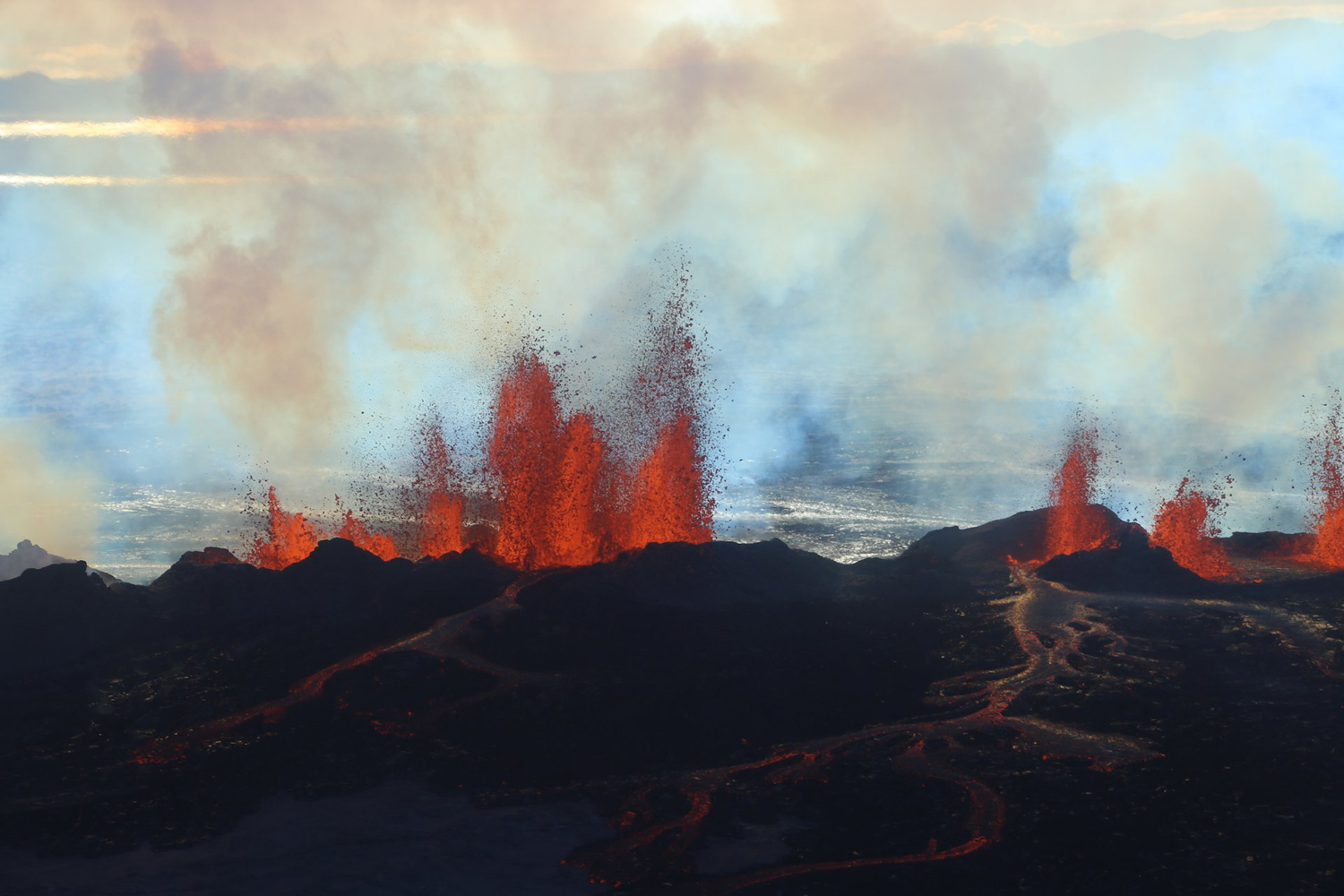 Sept. 2, 2014. In this aerial view, fountains of lava, up to 60 meters high, spurt from a fissure in the ground on the north side of the Bardarbunga volcano in Iceland.