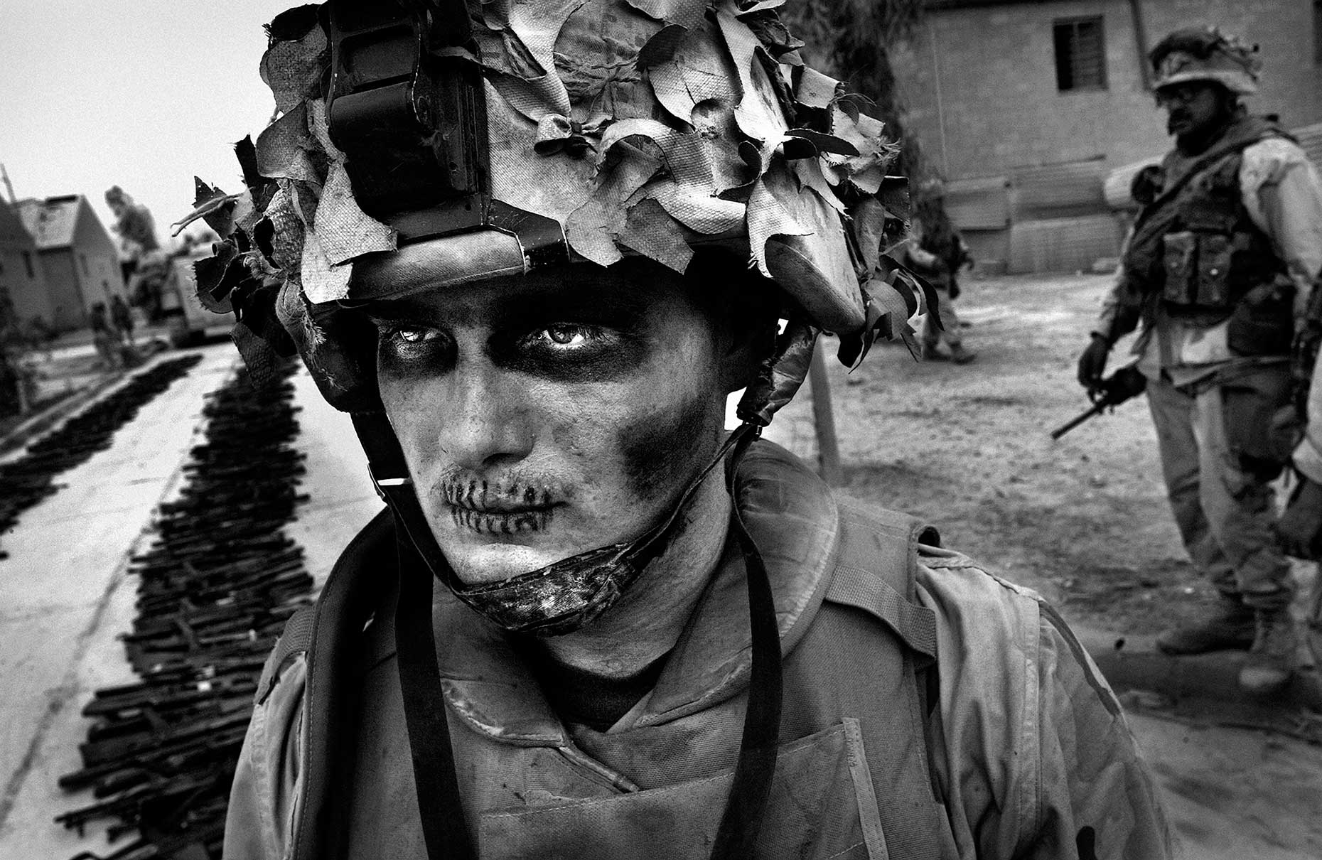 <b>Andrew Cutraro, April 8, 2003                                   </b>                                   I barely remember taking this photograph. I was totally unprepared for the physical and mental rigors of covering the Marines. I was exhausted and disoriented to a breaking point, so when I saw this scene, I thought I was hallucinating. The killing had picked up and become personal as the invasion force moved from the open desert into the urban areas. This photo was taken just outside Baghdad before it fell. The Marines were told to expect a bloody street-to-street fight for the capital and the men of Lima Co., 3/7 were steeling themselves for it.