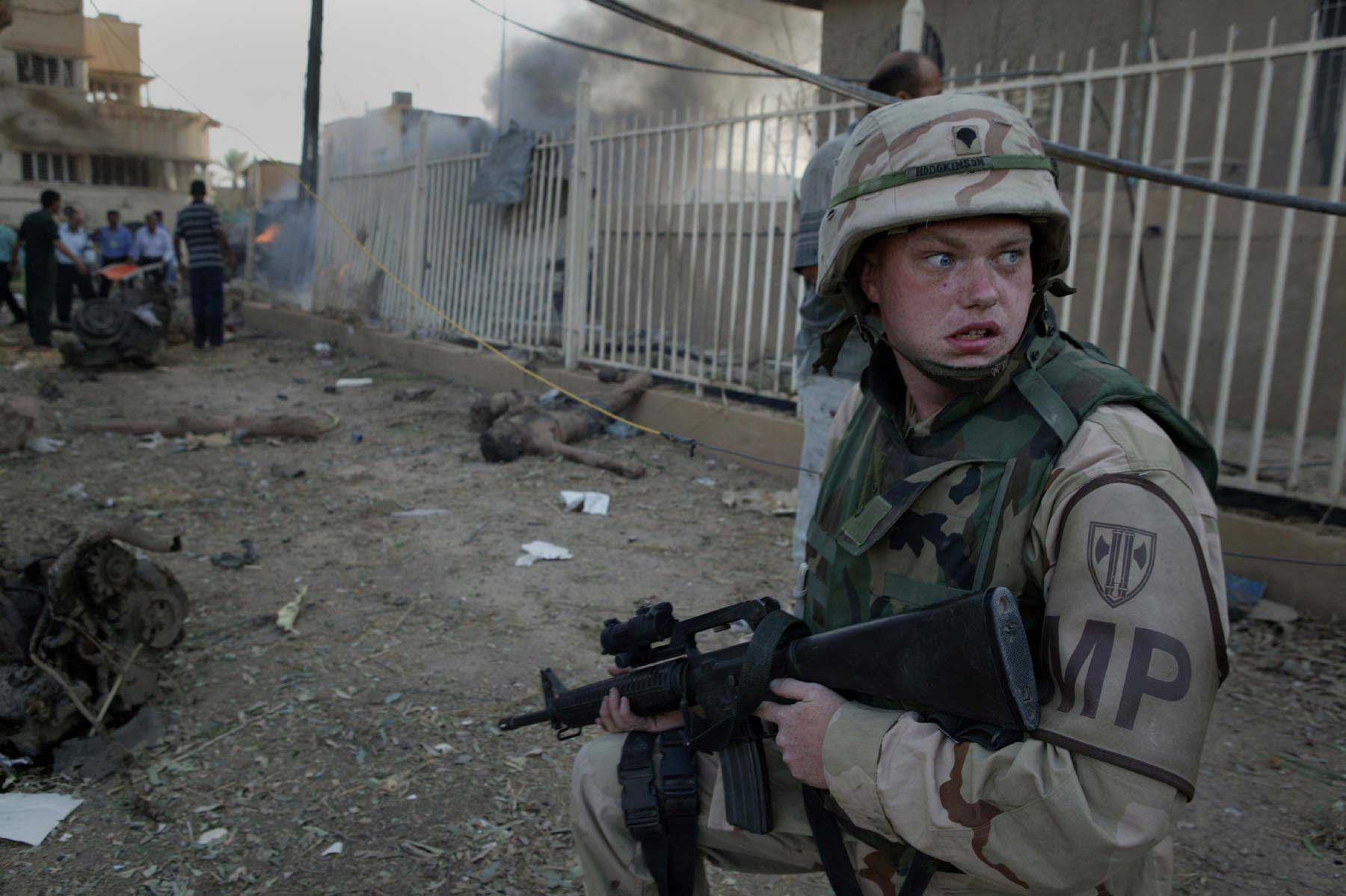 """<b>Mike Kamber, Oct. 27, 2003                                   </b>                                   This was the morning everything changed for me. U.S. combat troops were due to return home in a month and I'd been sent to Iraq to cover the """"return to normality,"""" as an editor put it. Joao Silva and I were standing around when an enormous explosion shook our house. The bombing turned out to be a mile away. We were first journalists on the scene and found the Red Cross destroyed by a truck bomb; dozens were killed. As we photographed, other explosions went off around the city. I thought this soldier's face said it all, the shock that there was to be no """"return to normality."""""""