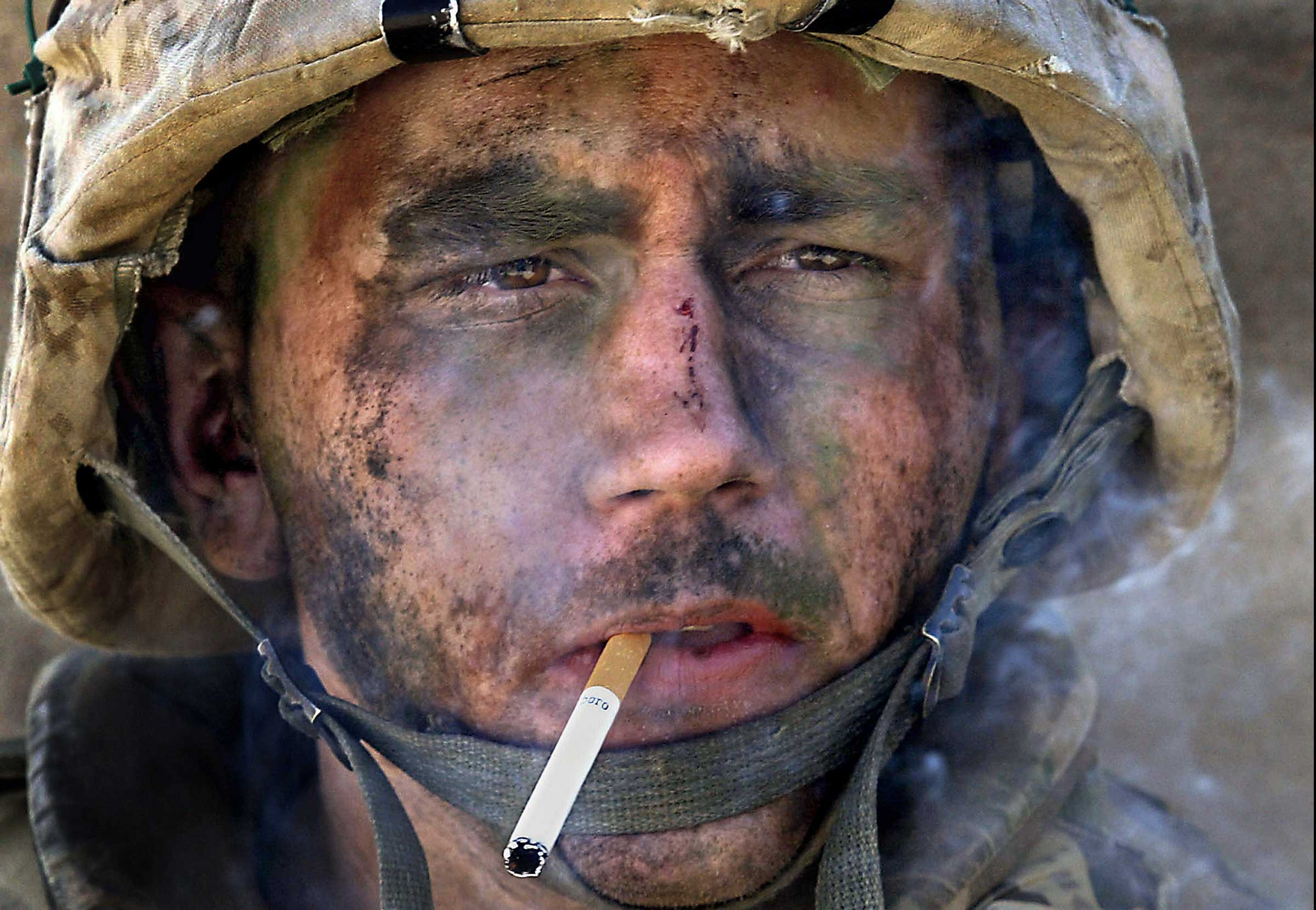"""<b>Luis Sinco, Nov. 2004                                   </b>                                   Marine Lance Corp. James Blake Miller was with the First Marine Battalion, 8th Regiment, during the assault on the insurgent stronghold of Fallujah. His life was forever altered in the crucible of battle. Filthy and exhausted, he lit a cigarette.                                    Arabs have two sayings: """"Insha-Allah"""" (God Willing) and """"Maktub"""" (It Is Written). Someday, somewhere in between, we may find truth."""