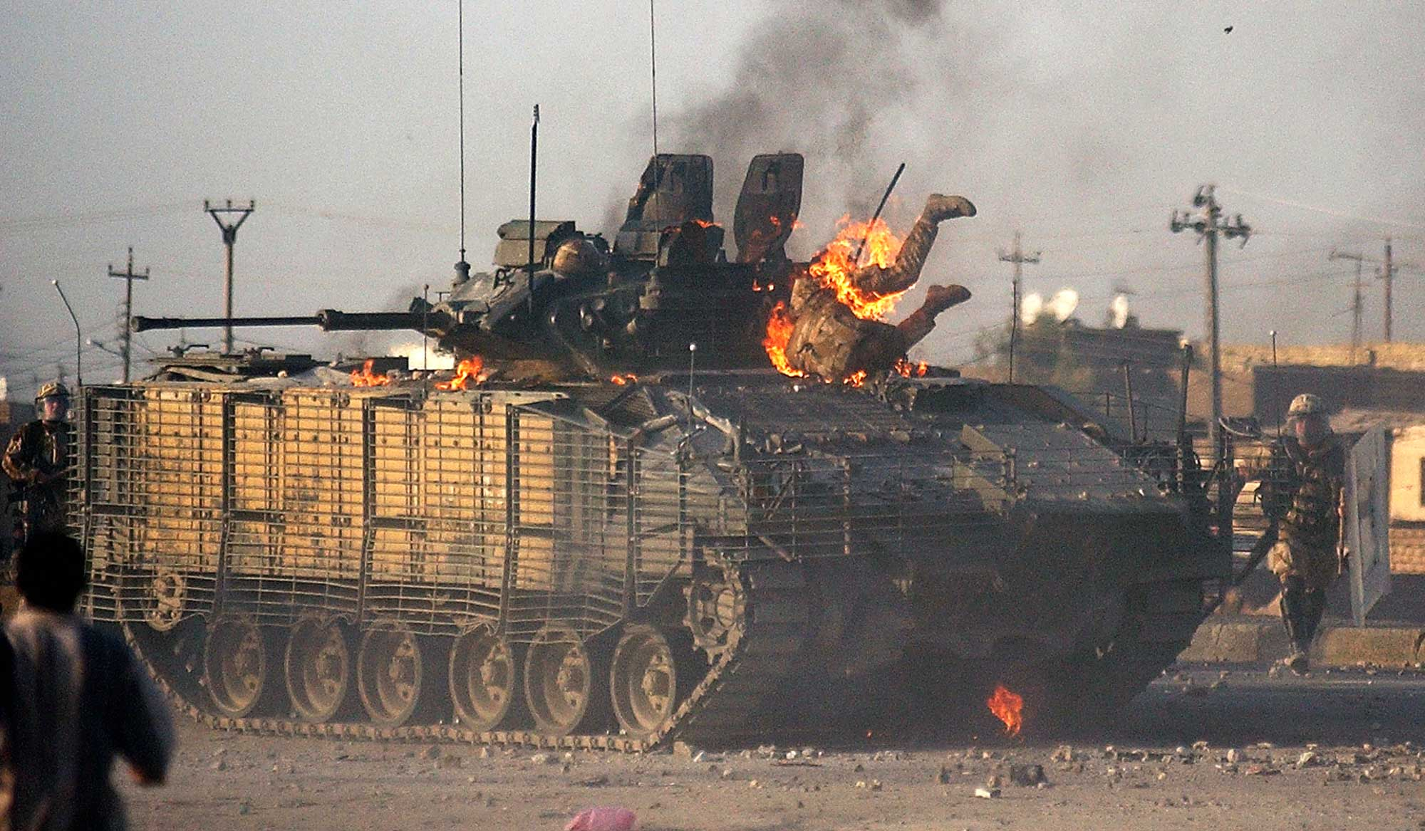 """<b>Nabil al-Jurani, Sept. 19, 2005                                   </b>                                   A British soldier makes his way out of a burning Warrior fighting vehicle in Basra, 340 miles southeast of Baghdad.                                    I remember that day. I remember the risk, fear and danger with mixed feelings: """"A man burns in front of my eyes, what should I do?"""" A part of me says, """"This is something that I do not care about,"""" but the other part says, """"The man is suffering. Go and save him. I feel his pain. Oh my Lord, why did you choose me to witness this? I am too weak for this."""" Harder than that, insurgents surrounded me — I had to pretend to be joyful but my heart was breaking.                                    After taking this image, I came to hate fire and I avoid the kitchen. I can't stand seeing my wife cooking. Sadness hung over me for a long time — I hope to one day see the soldier and check on him."""