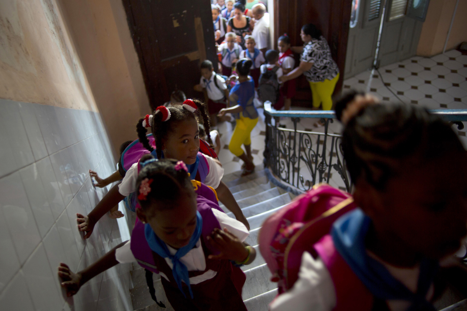 Sept. 1, 2014. Students walk up the stairs to their classrooms inside the Angela Landa elementary school the Old Havana, Cuba. Monday marks the first day back to class for students across Cuba.