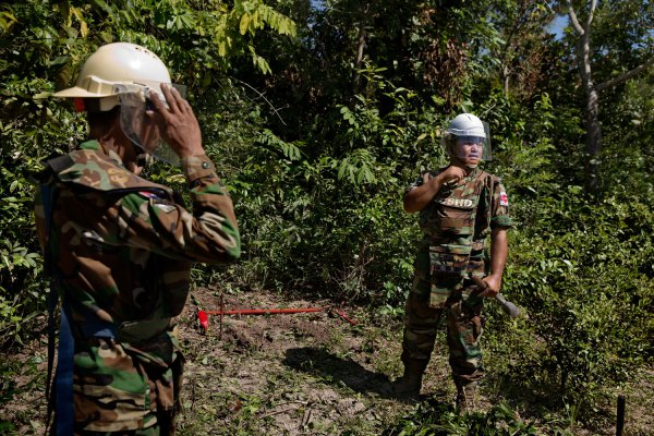 Aki Ra, right, at work with a member of his Cambodian Self Help Demining team in northwestern Cambodia