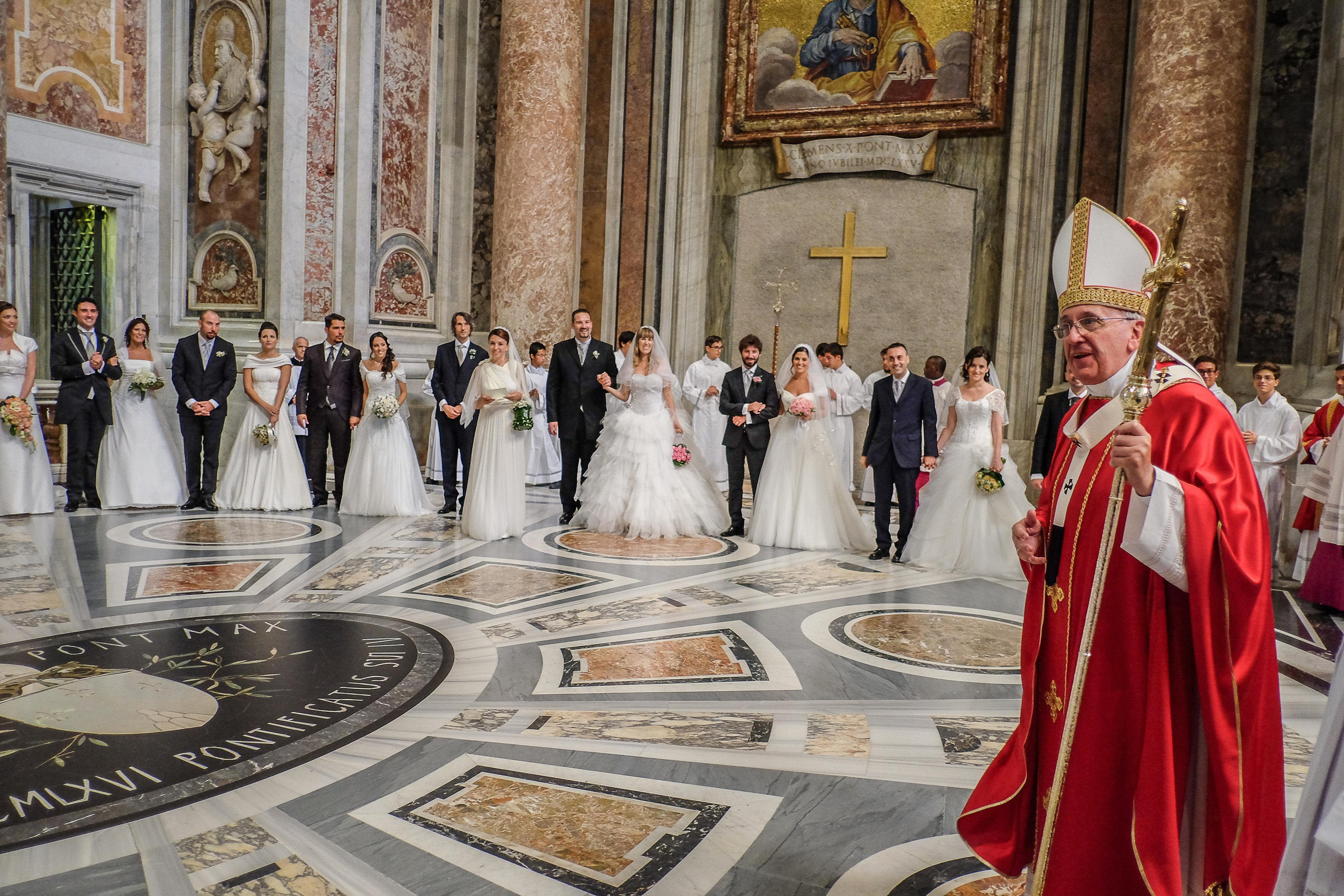 Pope Francis celebrates the wedding of 20 couples in St. Peter's Basilica in Vatican City on Sept. 14, 2014.