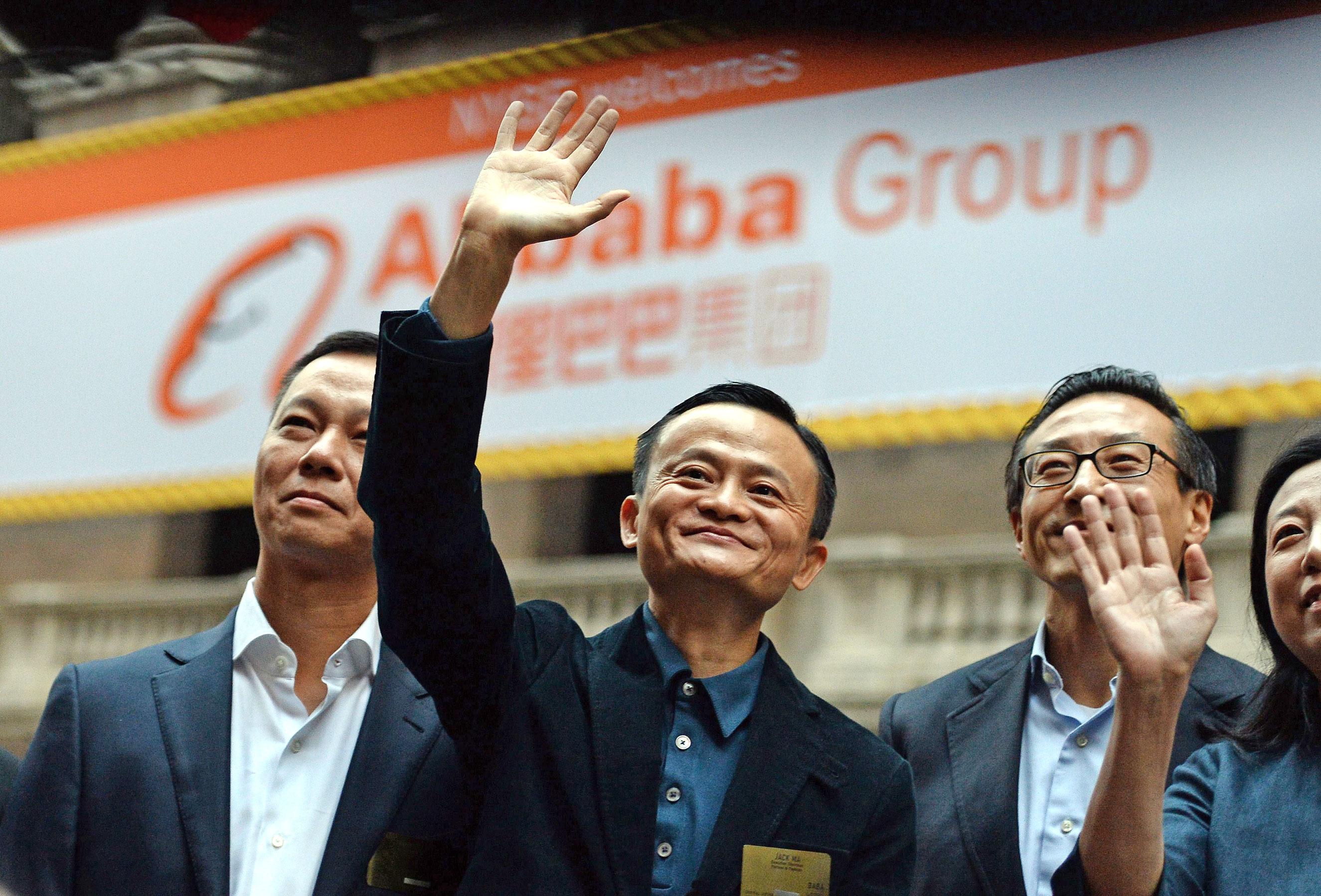 Chinese online retail giant Alibaba's executive chairman and founder Jack Ma (center) waves as he arrives at the New York Stock Exchange in New York City on Sept. 19, 2014.