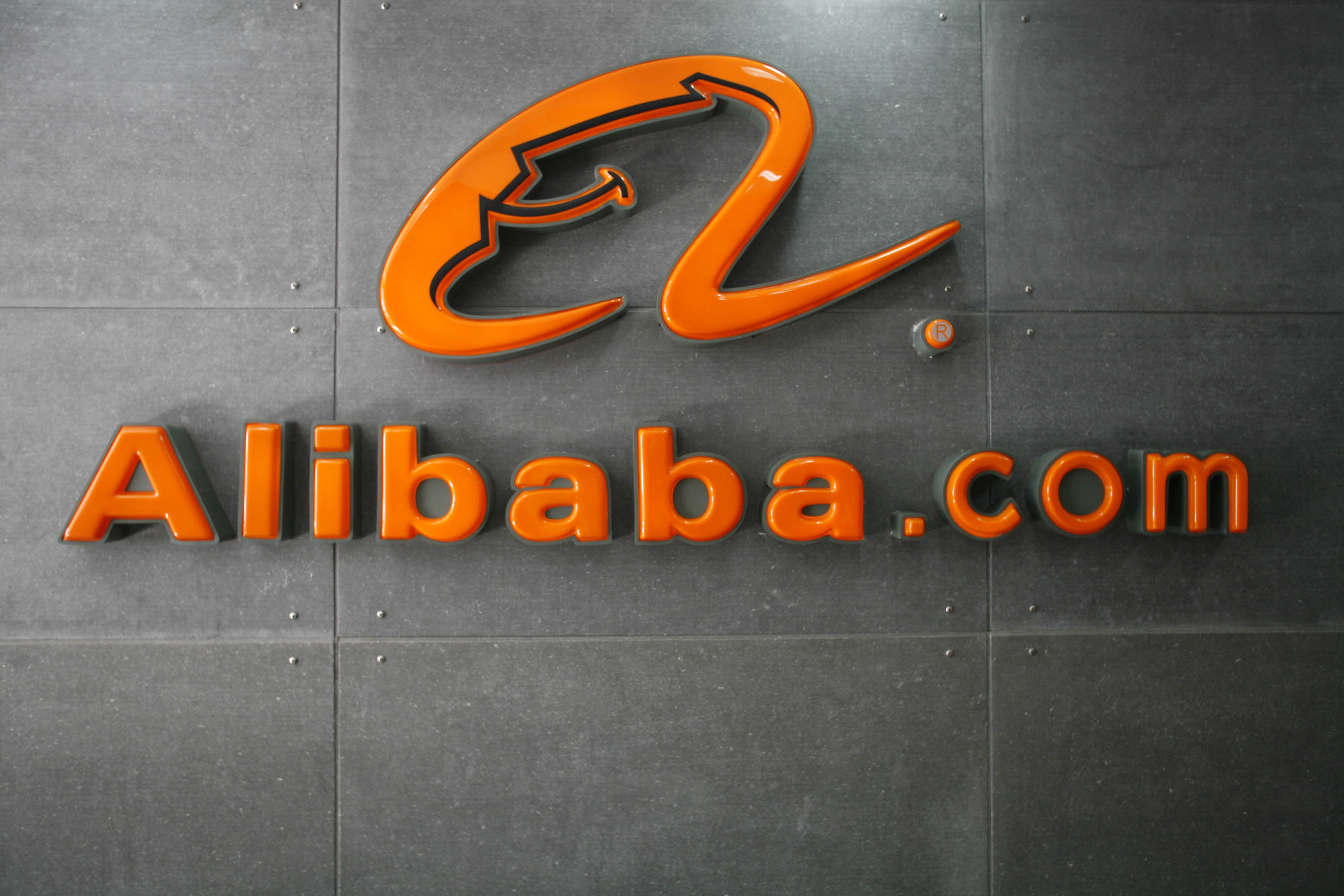 A logo hangs on the wall at the Alibaba.com head office in Hangzhou, China.