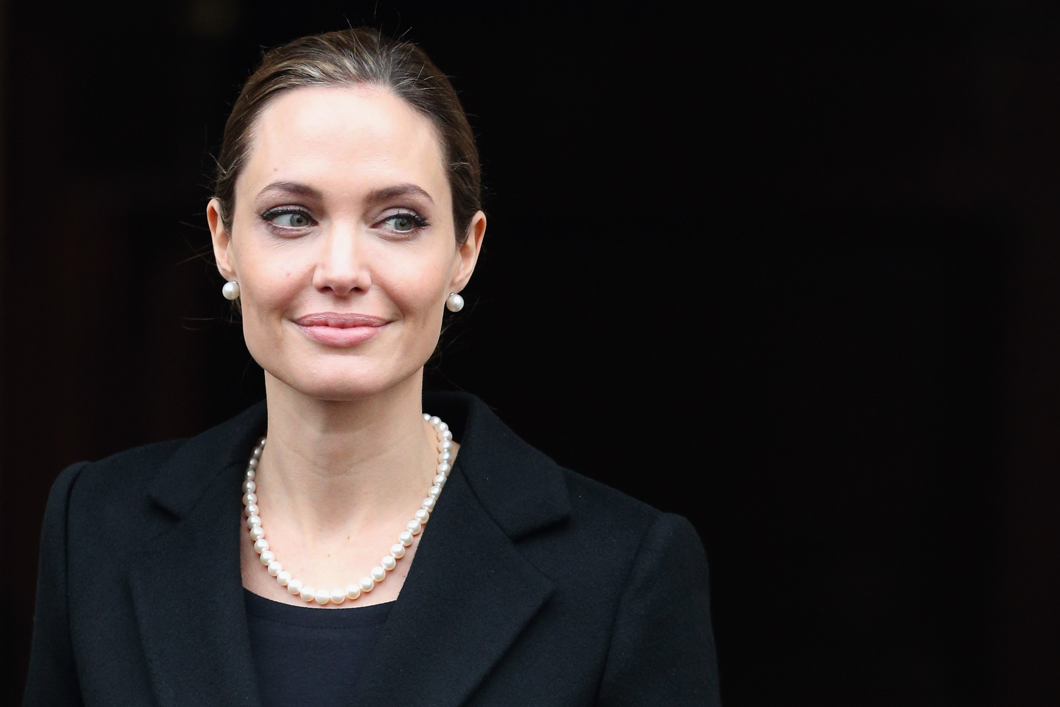 Actress Angelina Jolie leaves Lancaster House after attending the G8 Foreign Minsters' conference on April 11, 2013 in London.