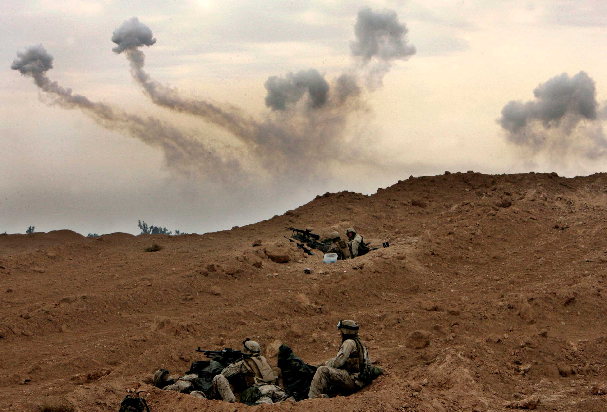 U.S. Marines of the 1st Division take position on the outskirts of Fallujah, Iraq, Nov. 8, 2004.